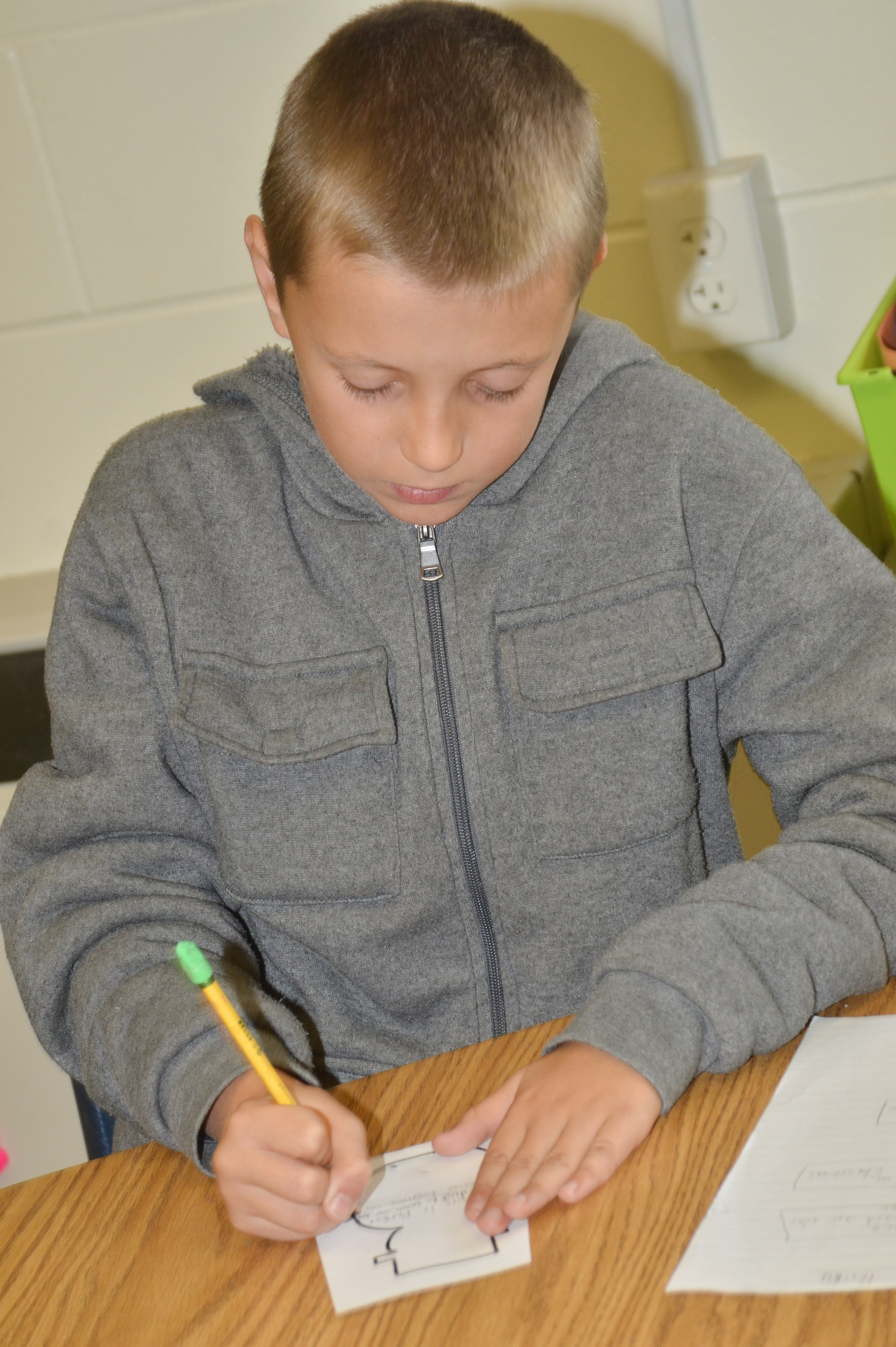 CES fourth-grader Cameron Taylor writes his Christmas haiku.
