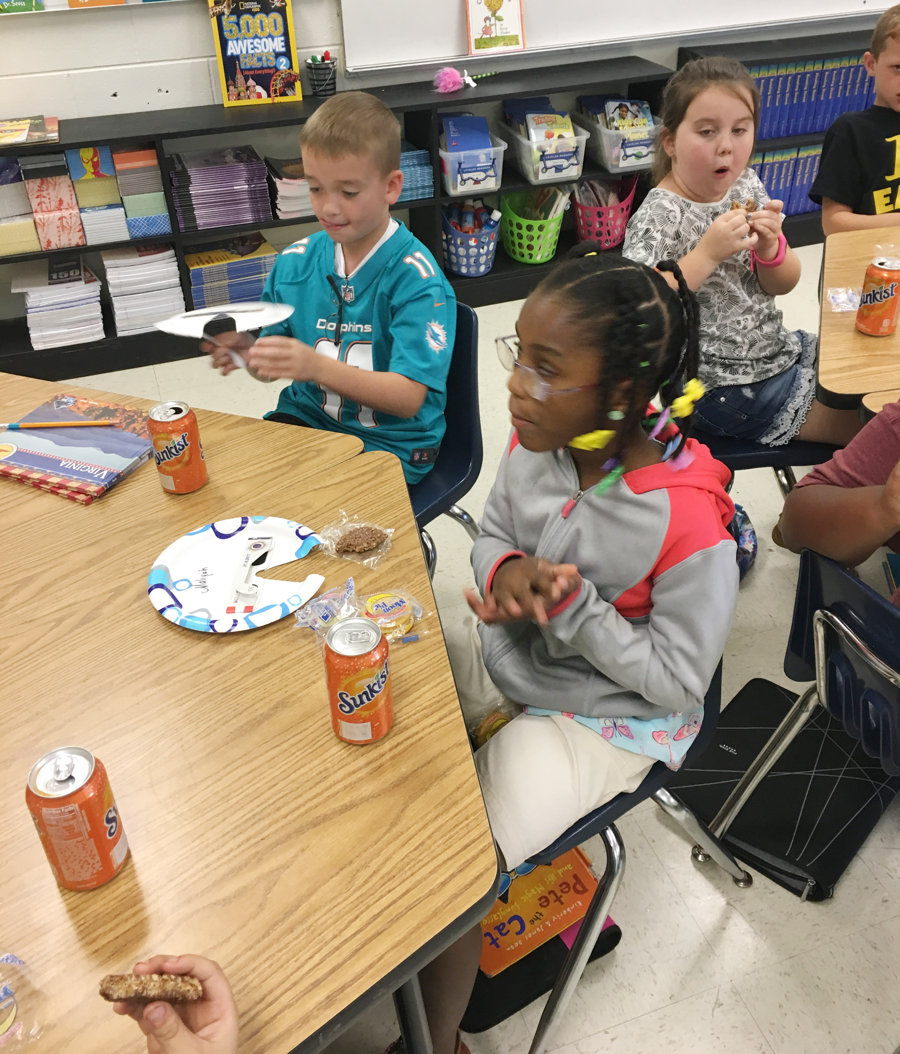 CES fourth-graders Cameron Estes, at left, and Maliyah Harris enjoy their Star Crunch and Moon Pie snacks.
