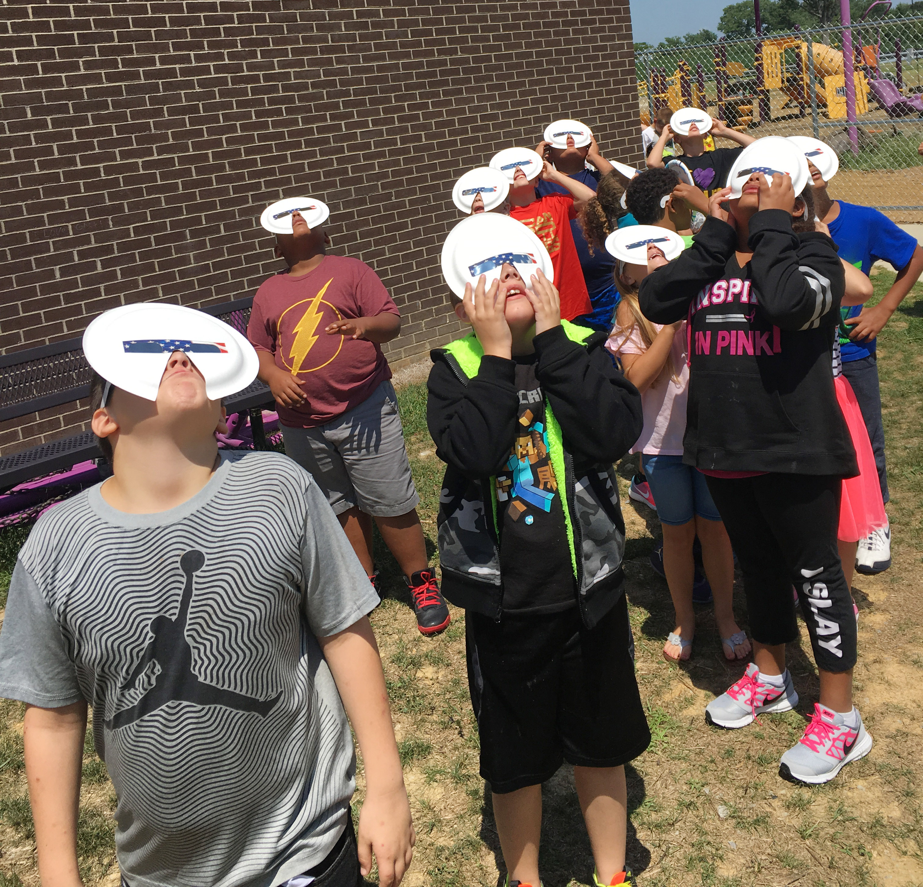 CES fourth-graders watch the solar eclipse.