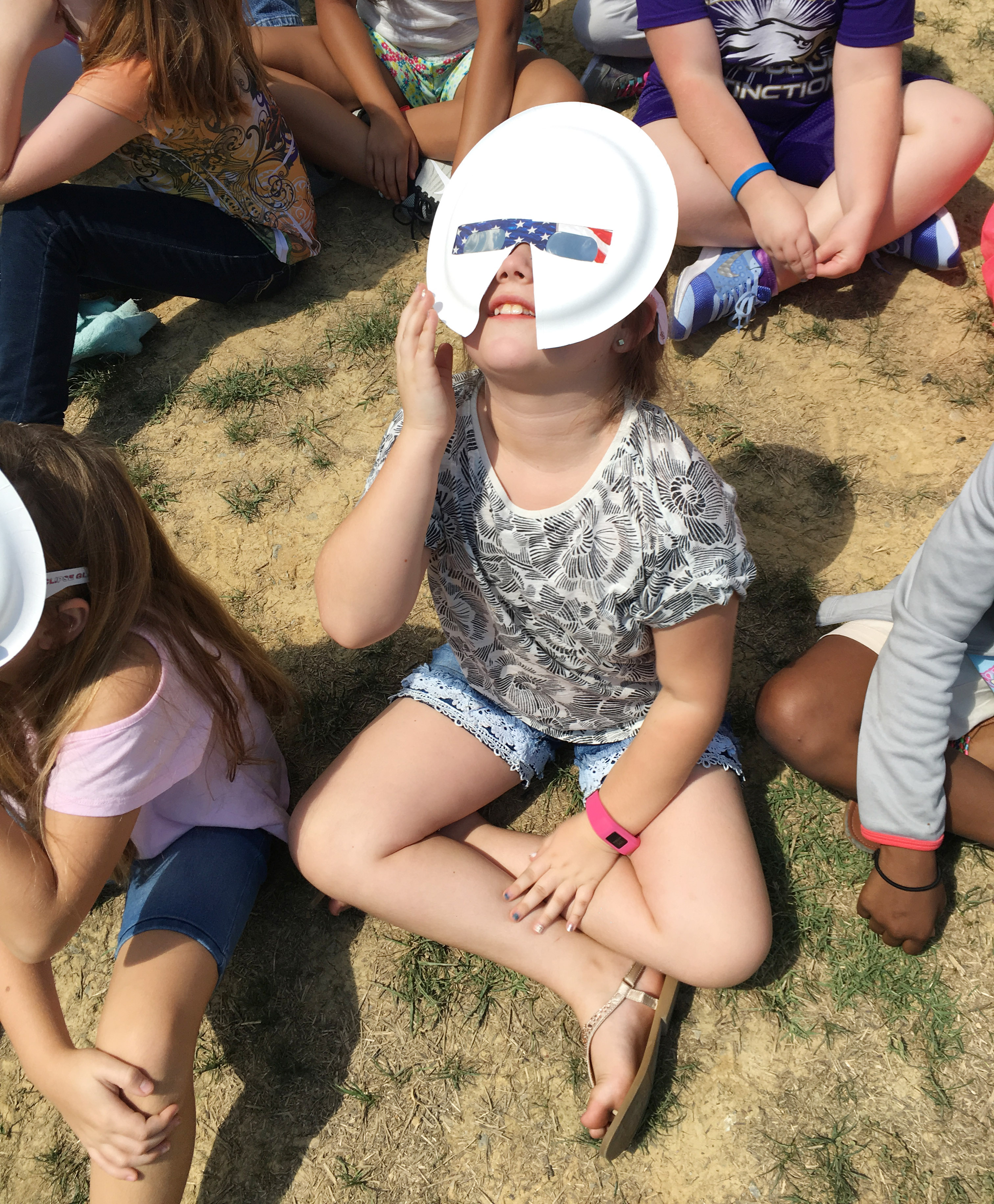 CES fourth-grader Maylee Wilds watches the solar eclipse.