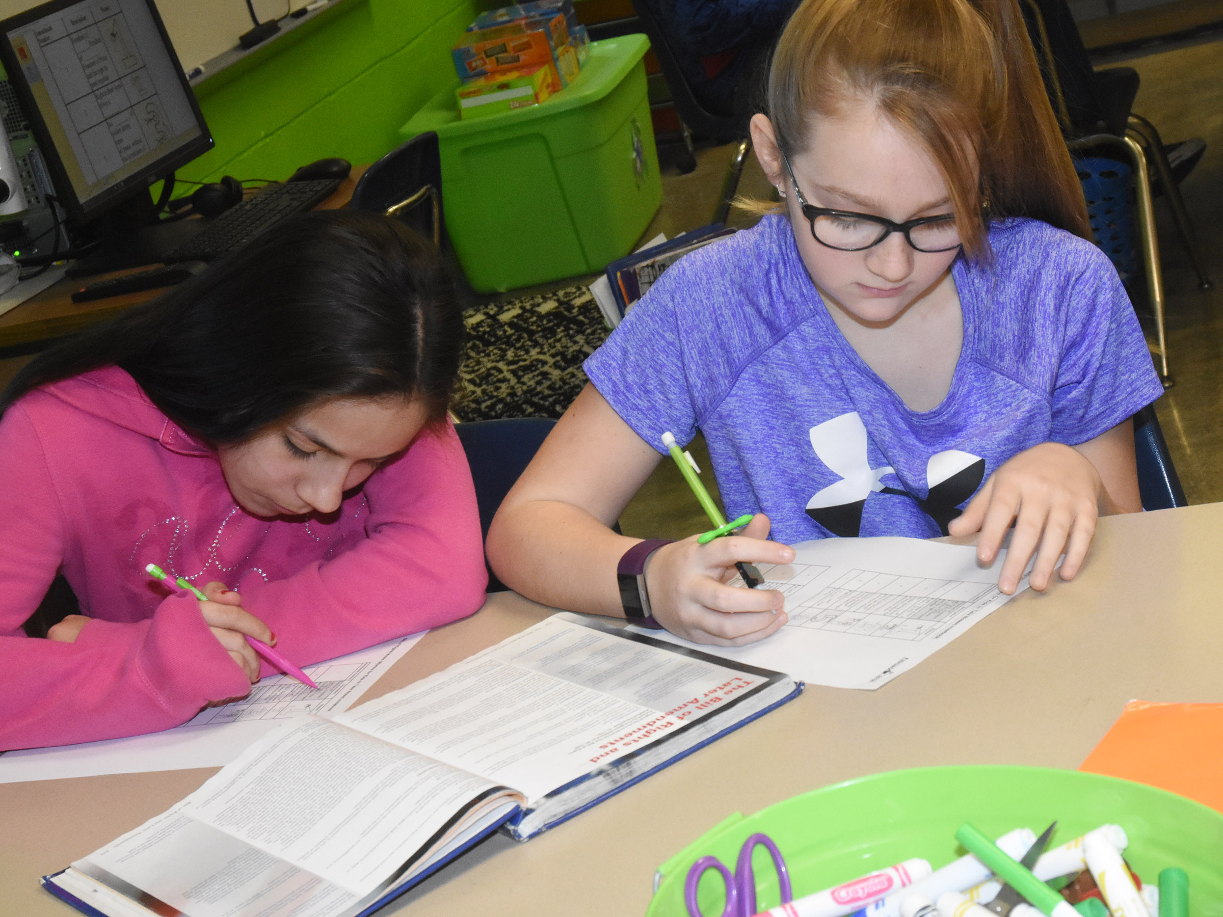 CES fifth-graders Marissa Segura, at left, and Lilyan Murphy read notes about the Bill of Rights.