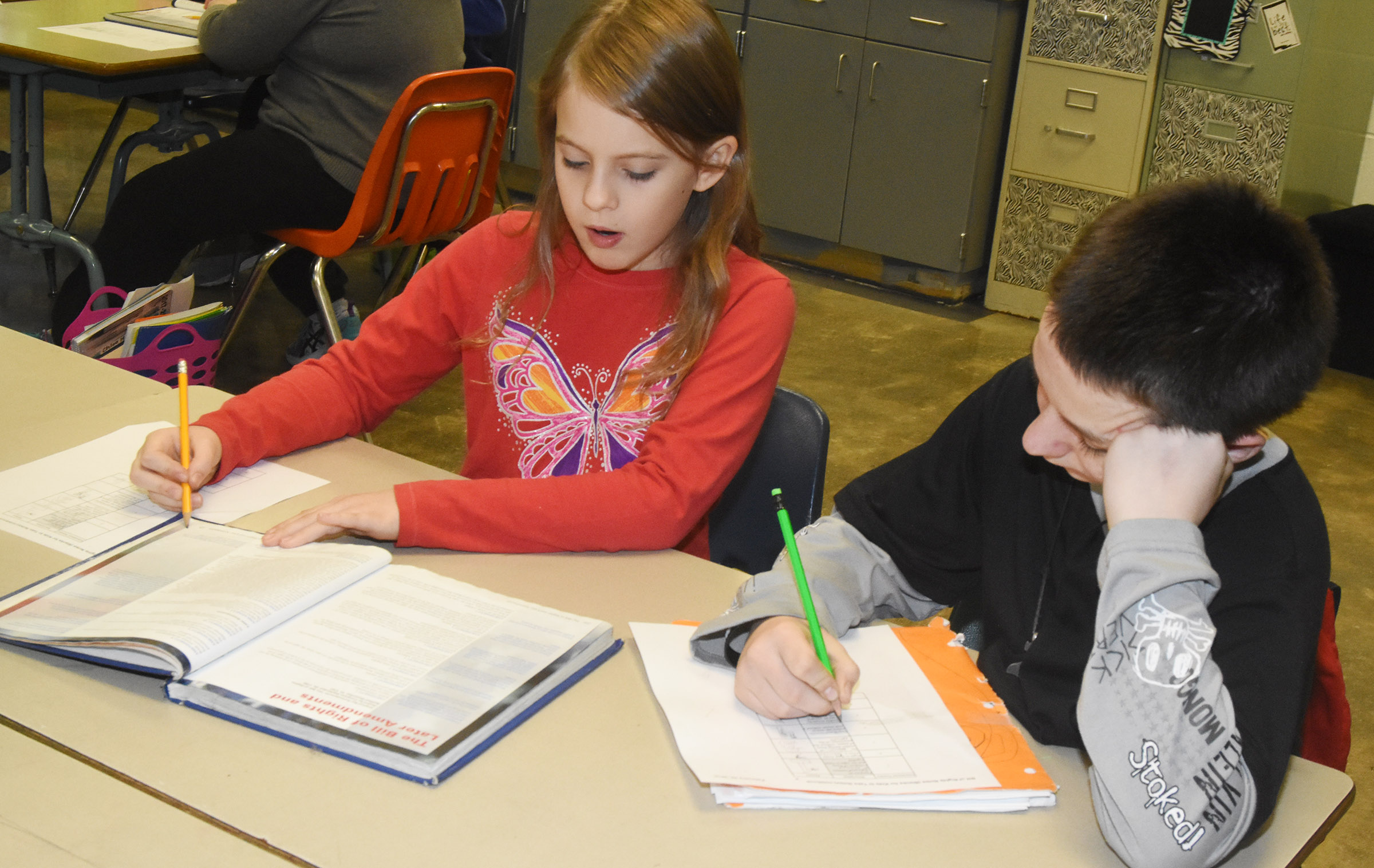 CES fifth-graders Ellie Wise, at left, and Chris Cox work together as they learn about the Bill of Rights.