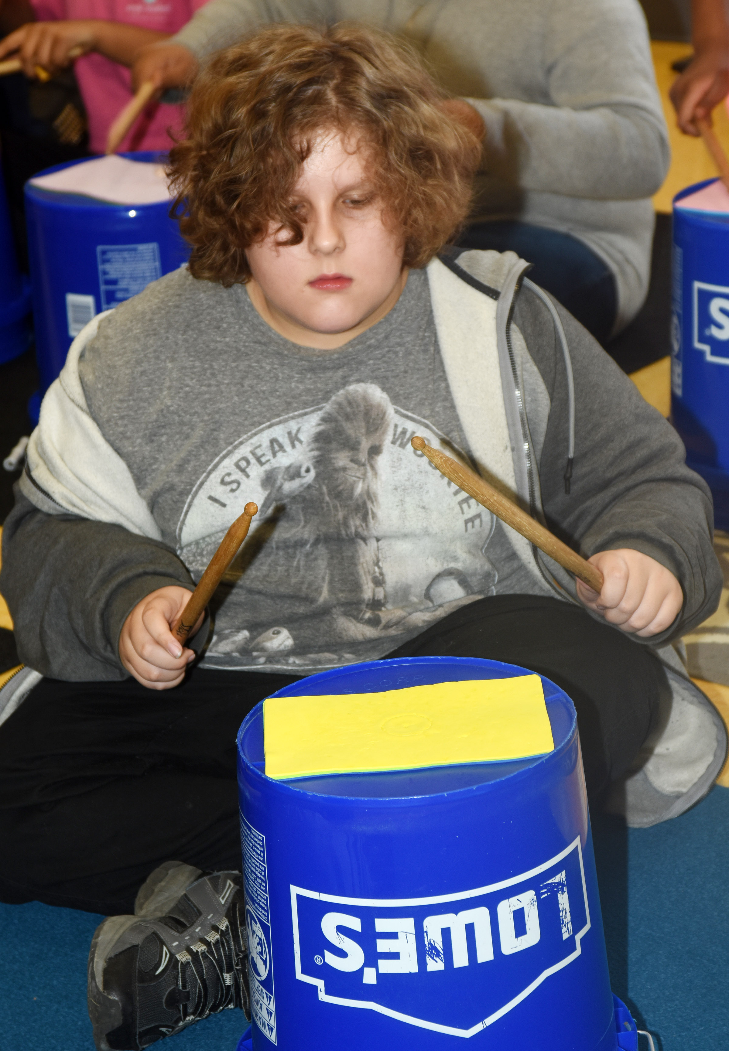 CES fifth-grader Zeke Harris plays the bucket drums.