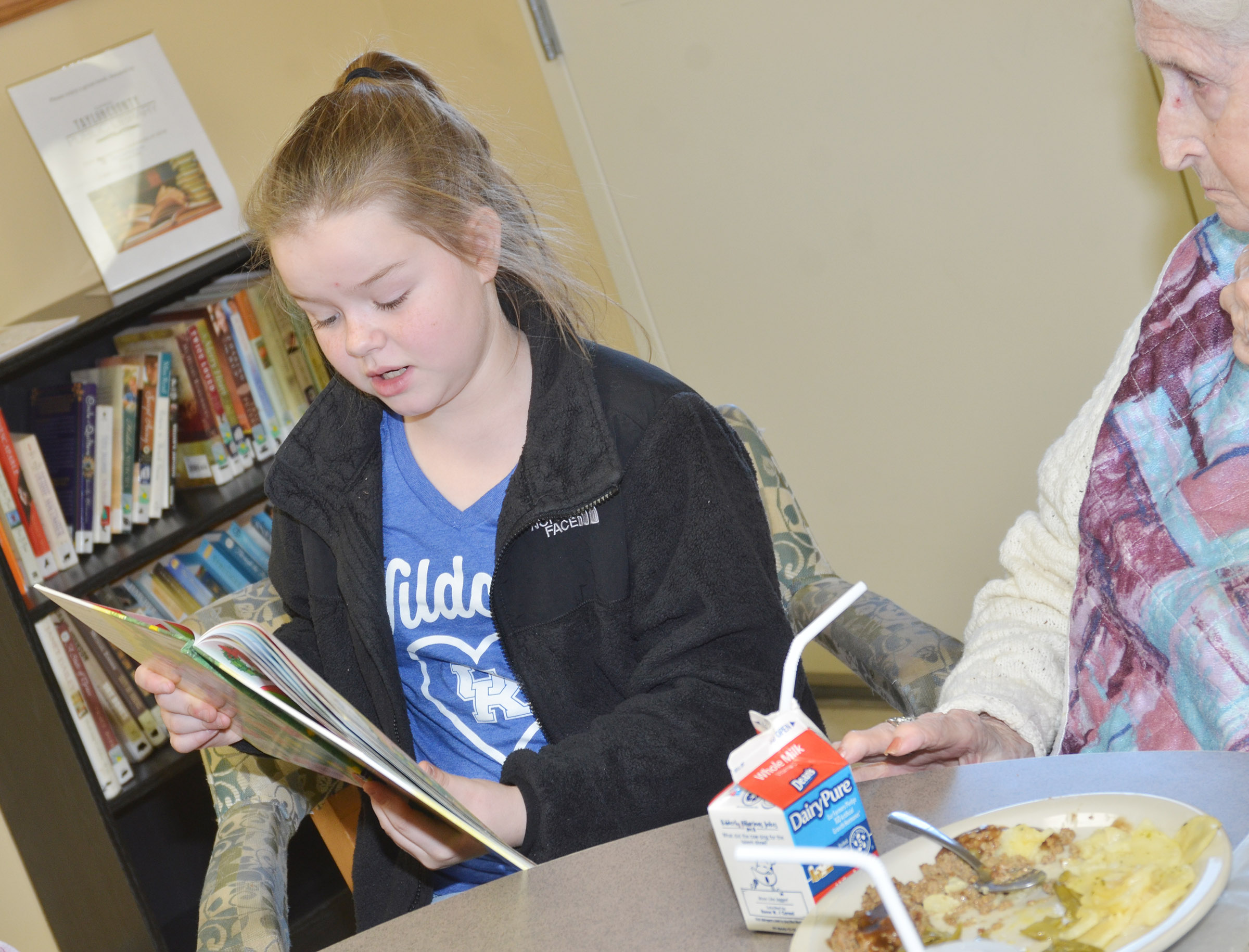 CES fifth-grader Miley Hash reads to a Grandview resident.