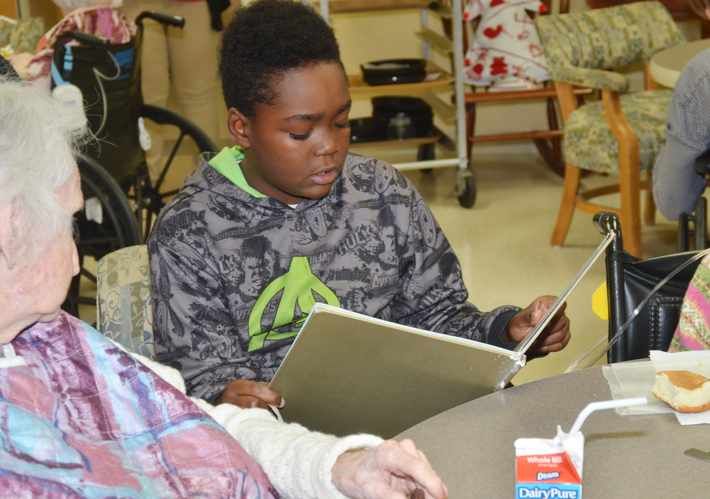 CES fifth-grader Deason Smith reads to a Grandview resident.