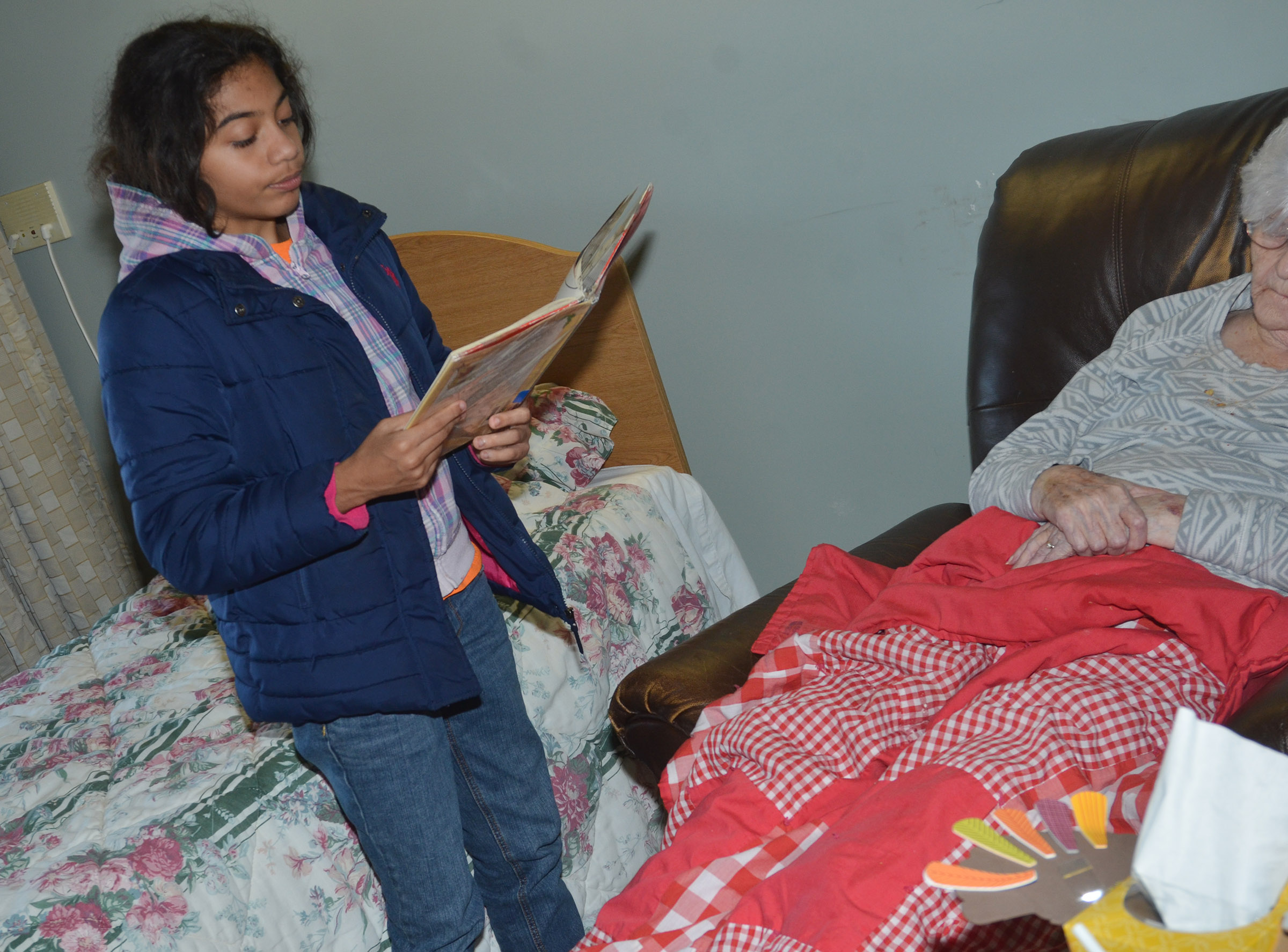 CES fifth-grader Falicity Lewis reads to a Grandview resident.