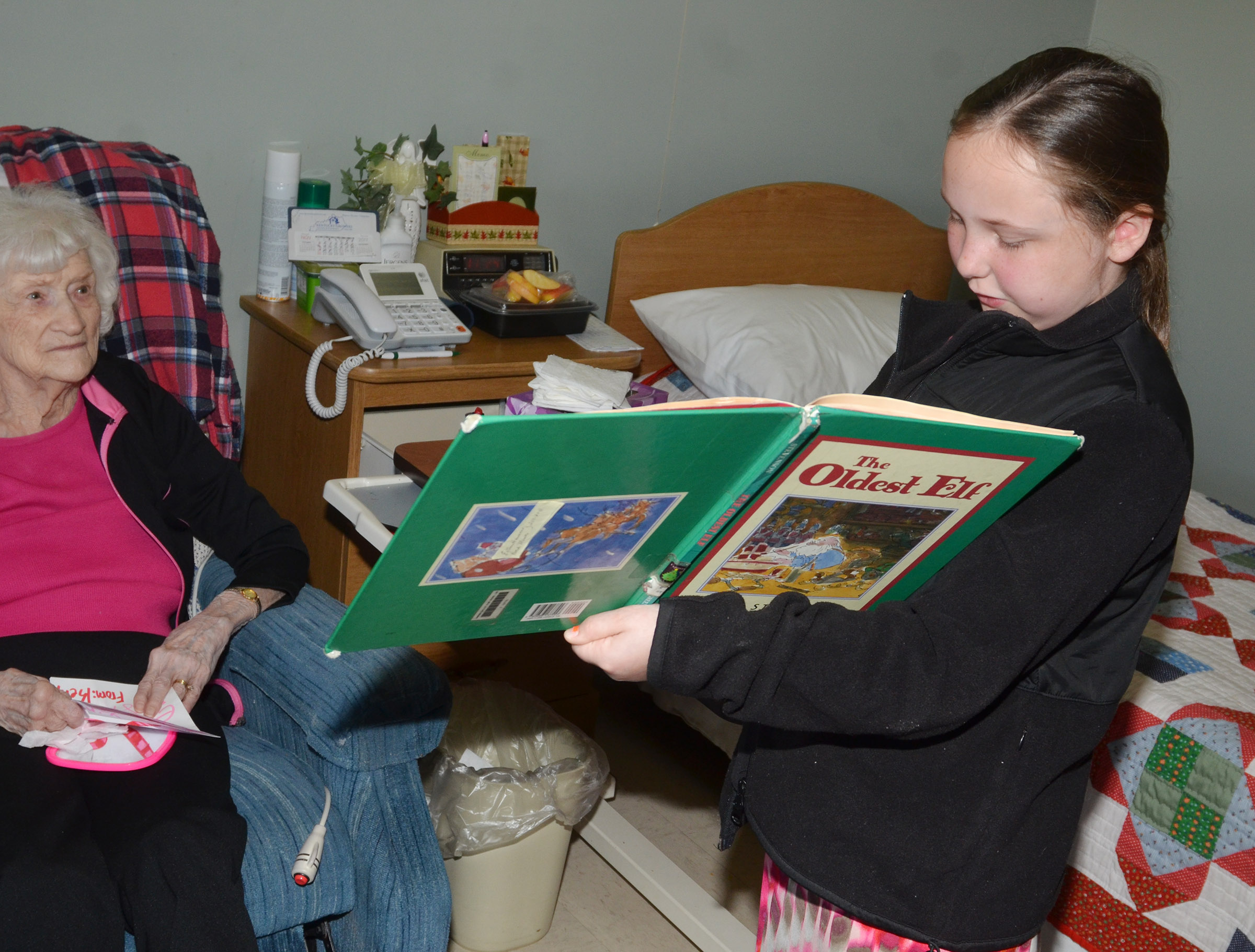 CES fifth-grader Shyanna Young reads to a Grandview resident.