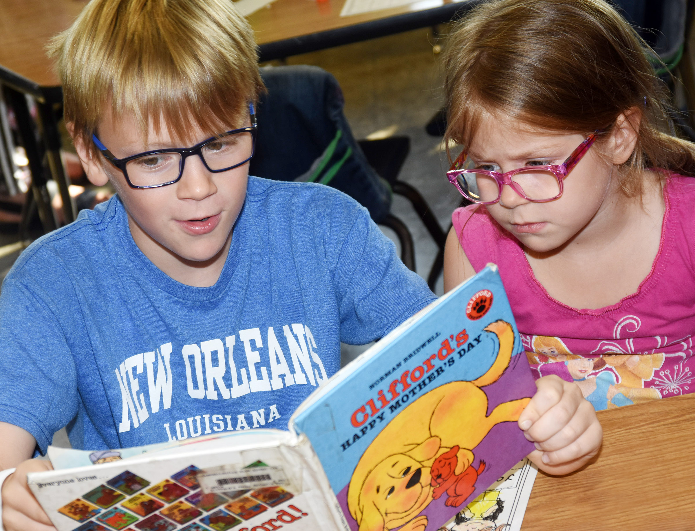 CES fifth-grader Connor Coots read to his sister, kindergartener Charlotte Coots.