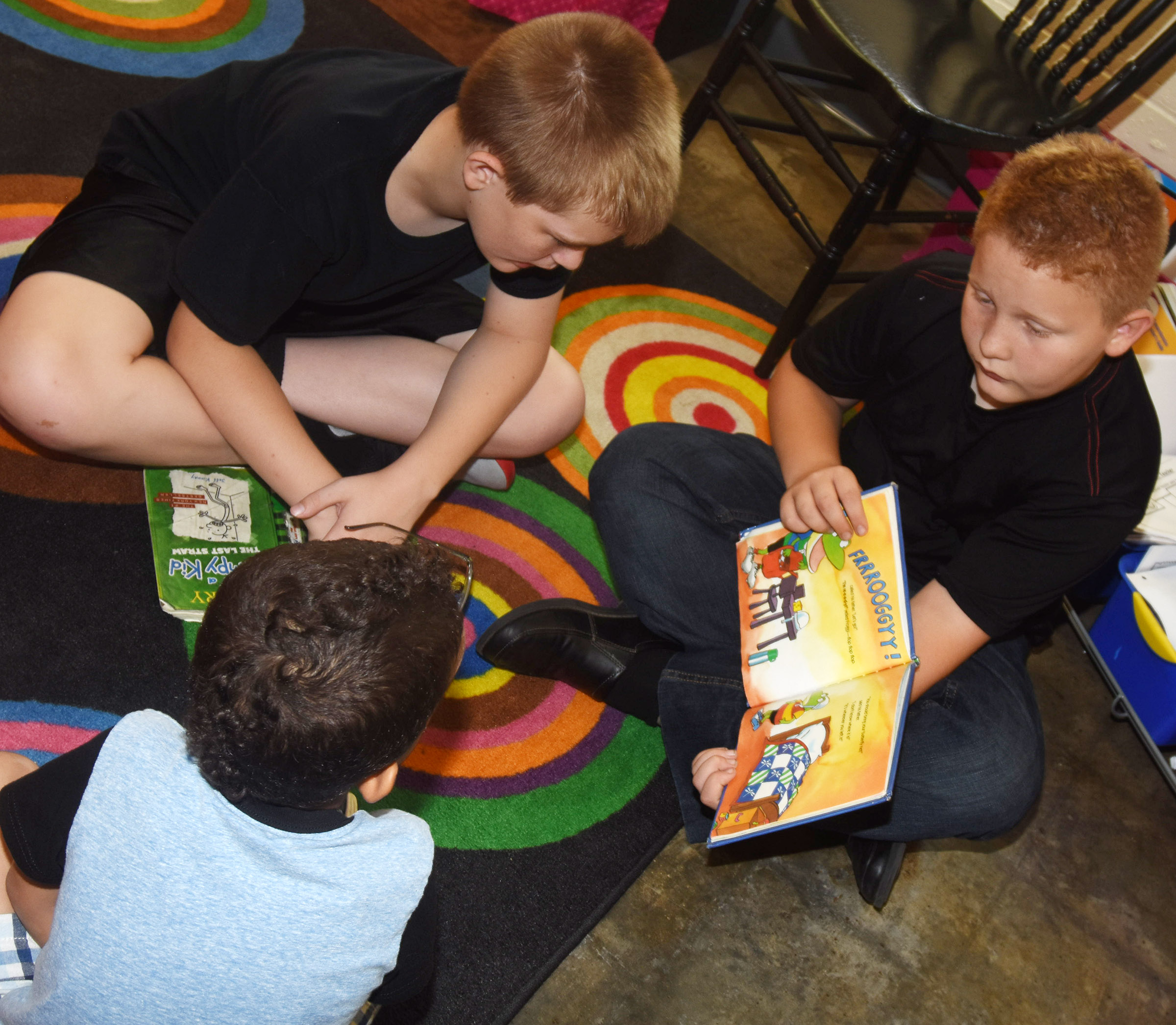 CES fifth-graders Cash Cowan, at left, and Isaiah Jeffries read to kindergarteners.