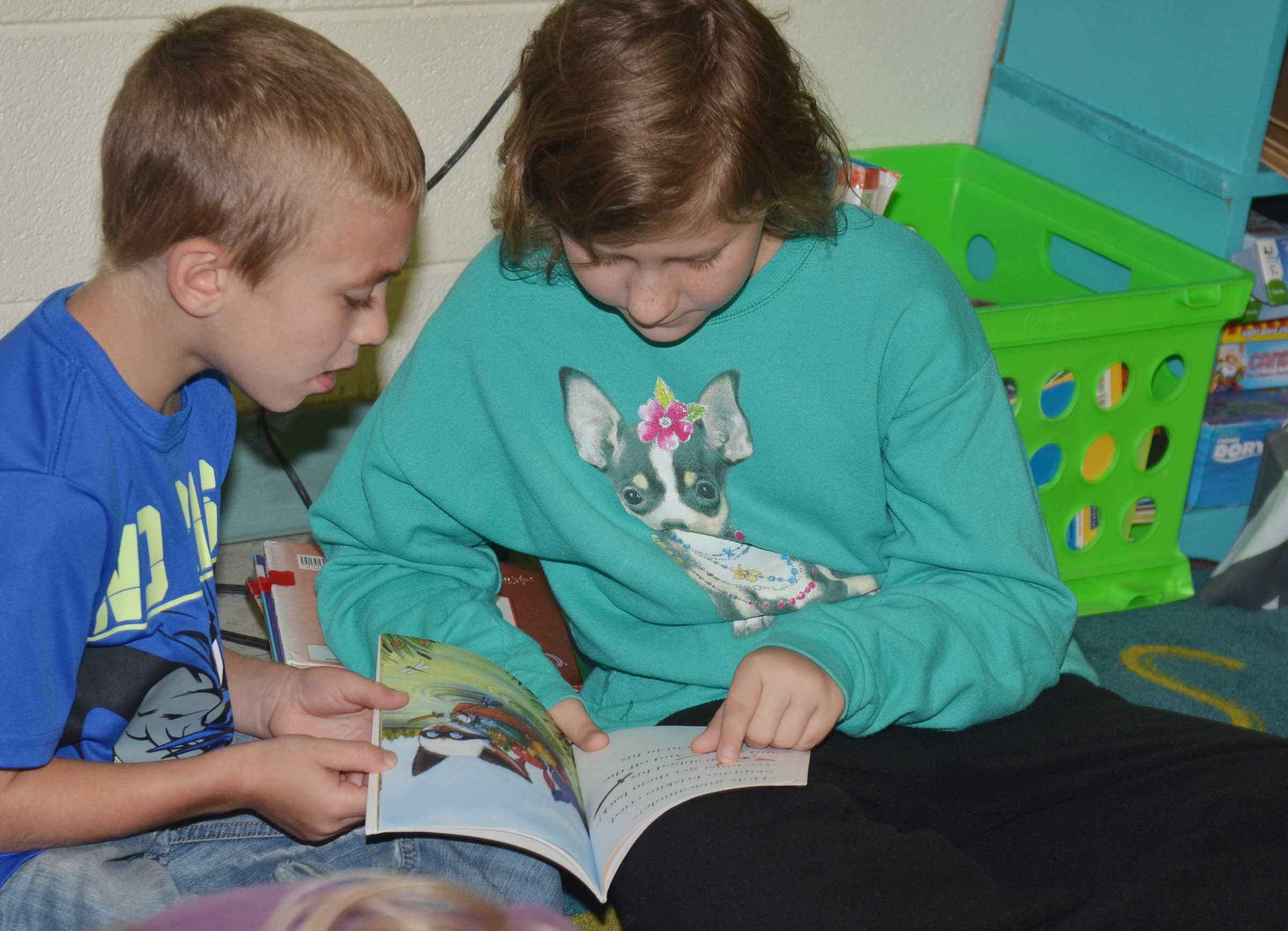 CES fifth-grader Bryanna Fitzgerald reads to first-grader Tyler Bryant.