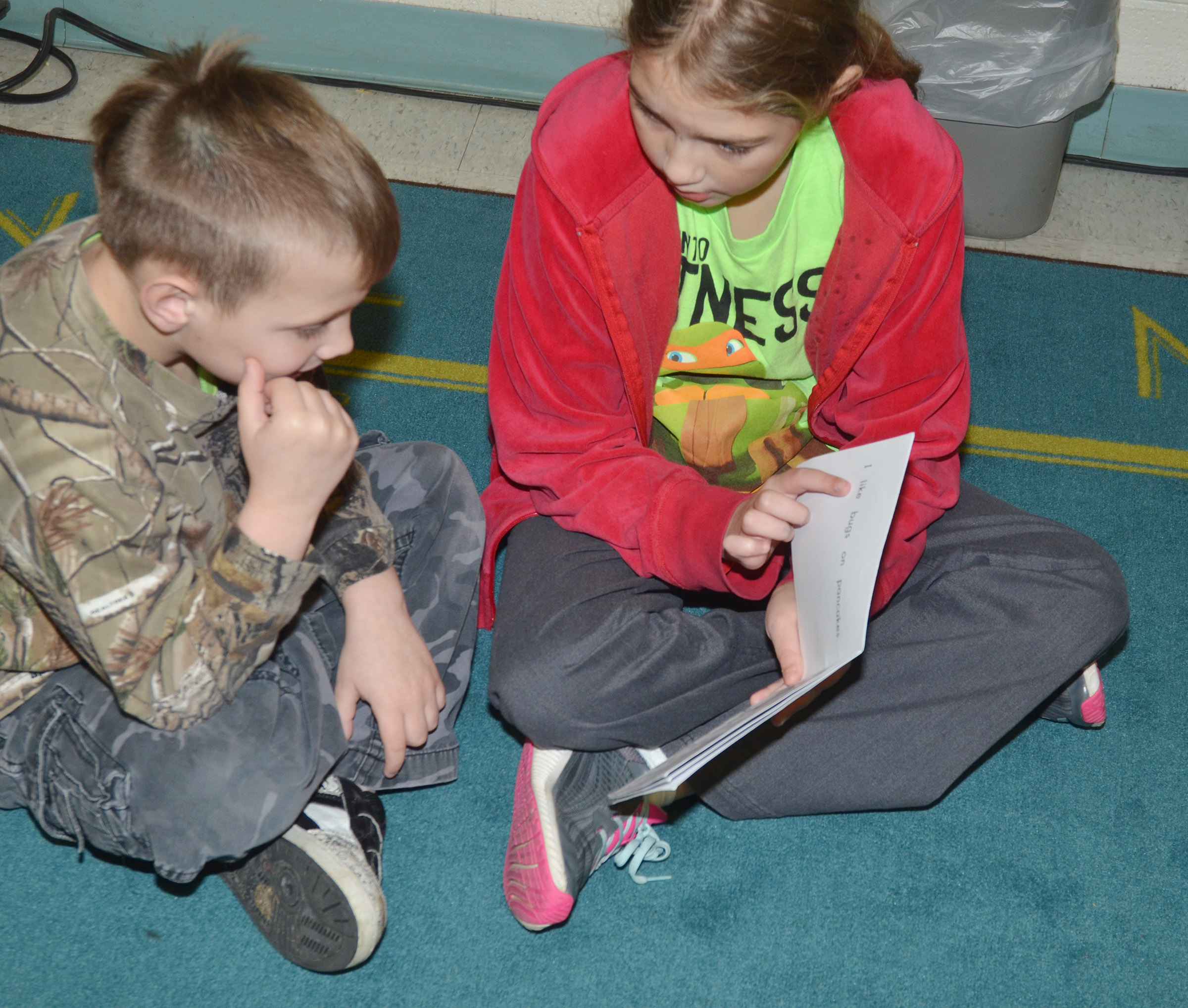 CES fifth-grader Harley Couch-Allen reads to first-grader John Lane.