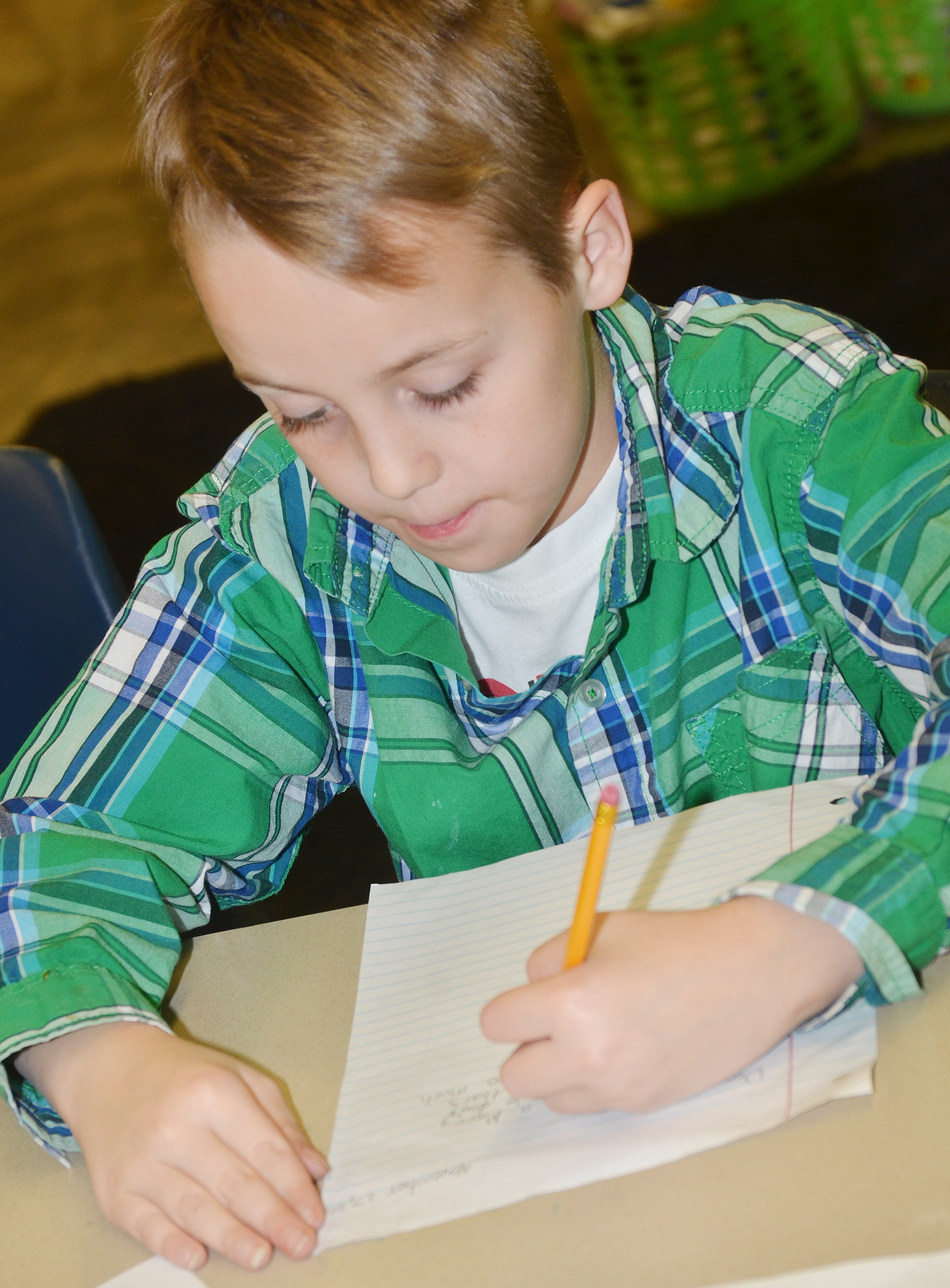 CES fifth-grader Spencer Bates practices the parts of a letter by writing a letter to Santa.