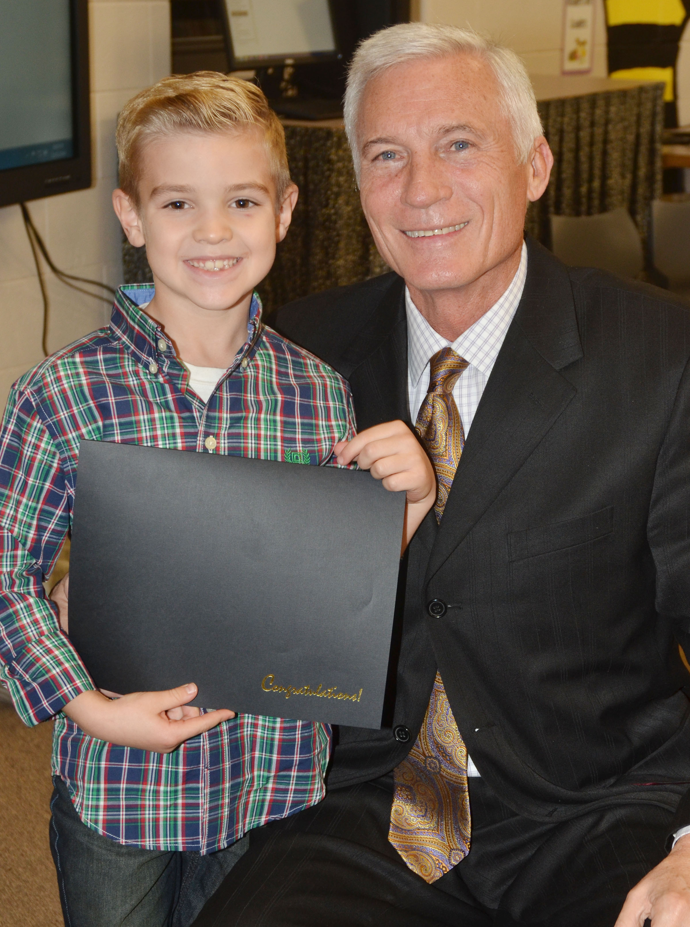 CES first-grader Dax Gray is honored for being an Academic Achiever for December. He is pictured with CIS Superintendent Mike Deaton.