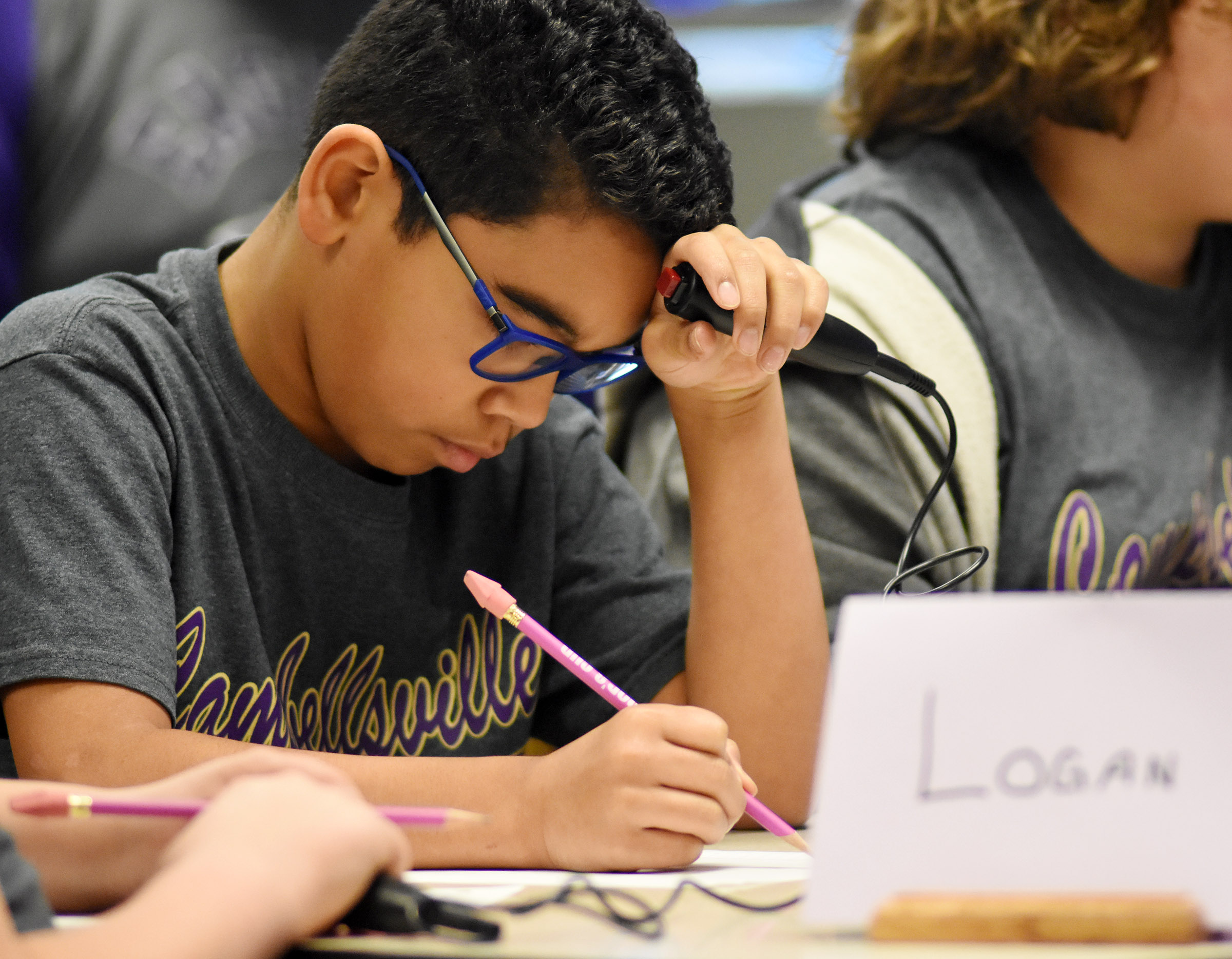 CES fifth-grader Gabriel Noyola works a math problem during a quick recall match.