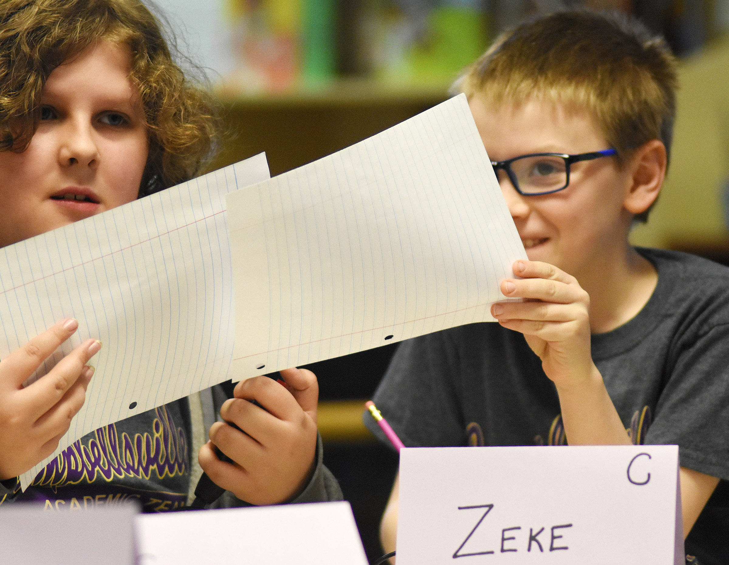 CES fifth-grader Zeke Harris, at left, and fourth-grader Connor Coots discuss a question during a quick recall match.