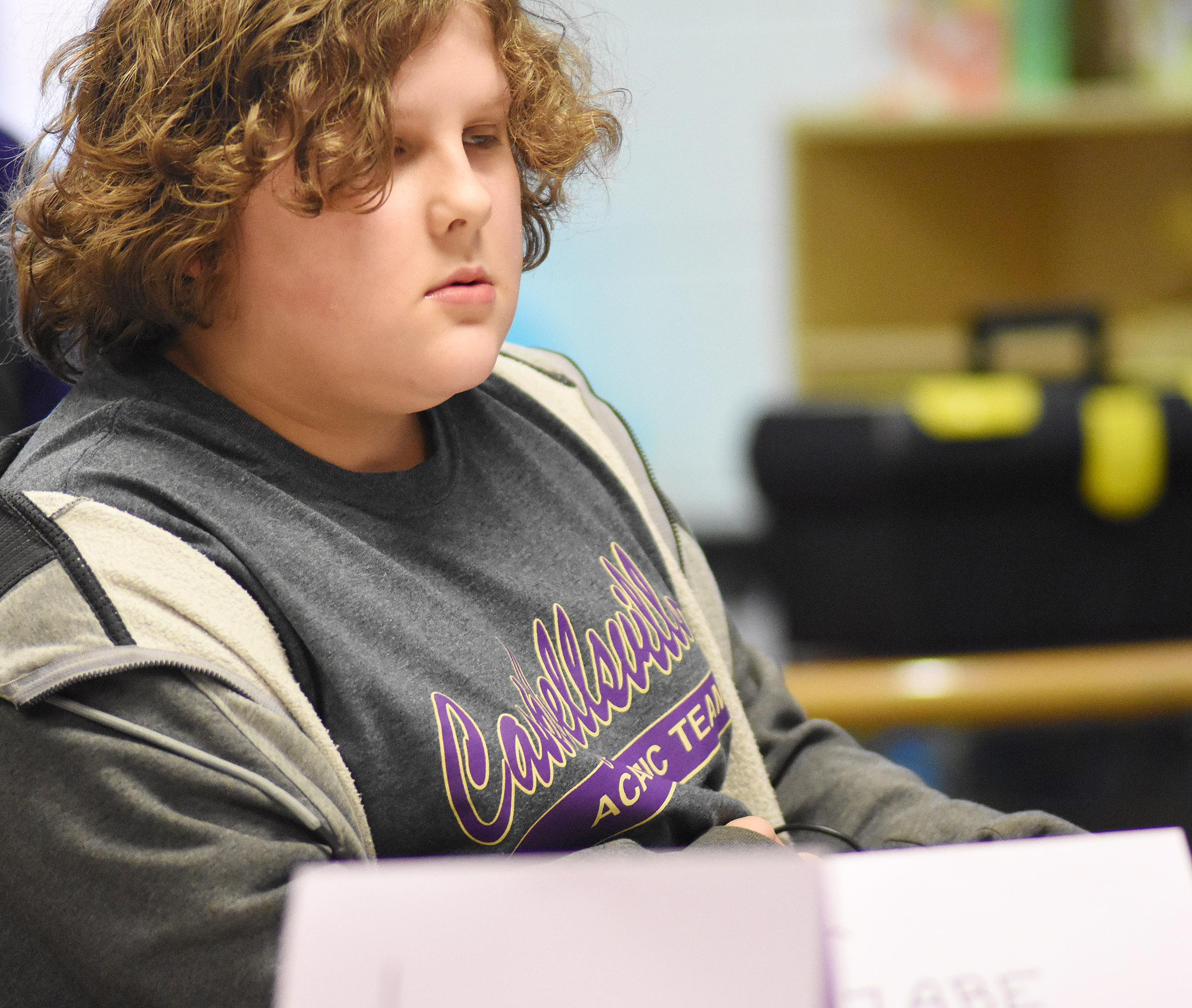 CES fifth-grader Zeke Harris listens to a question during a quick recall match.
