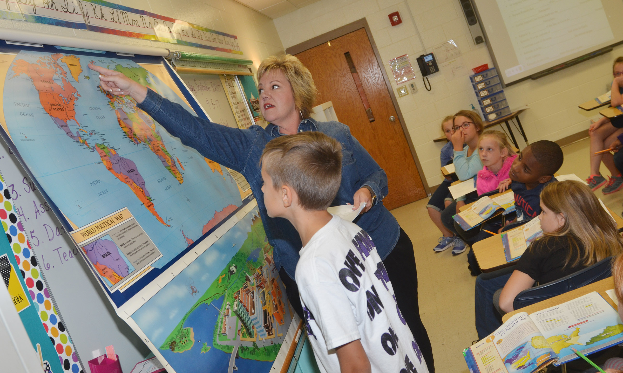 CES fourth-grade teacher Kaye Agathen shows her students that the United States is in the northern hemisphere.