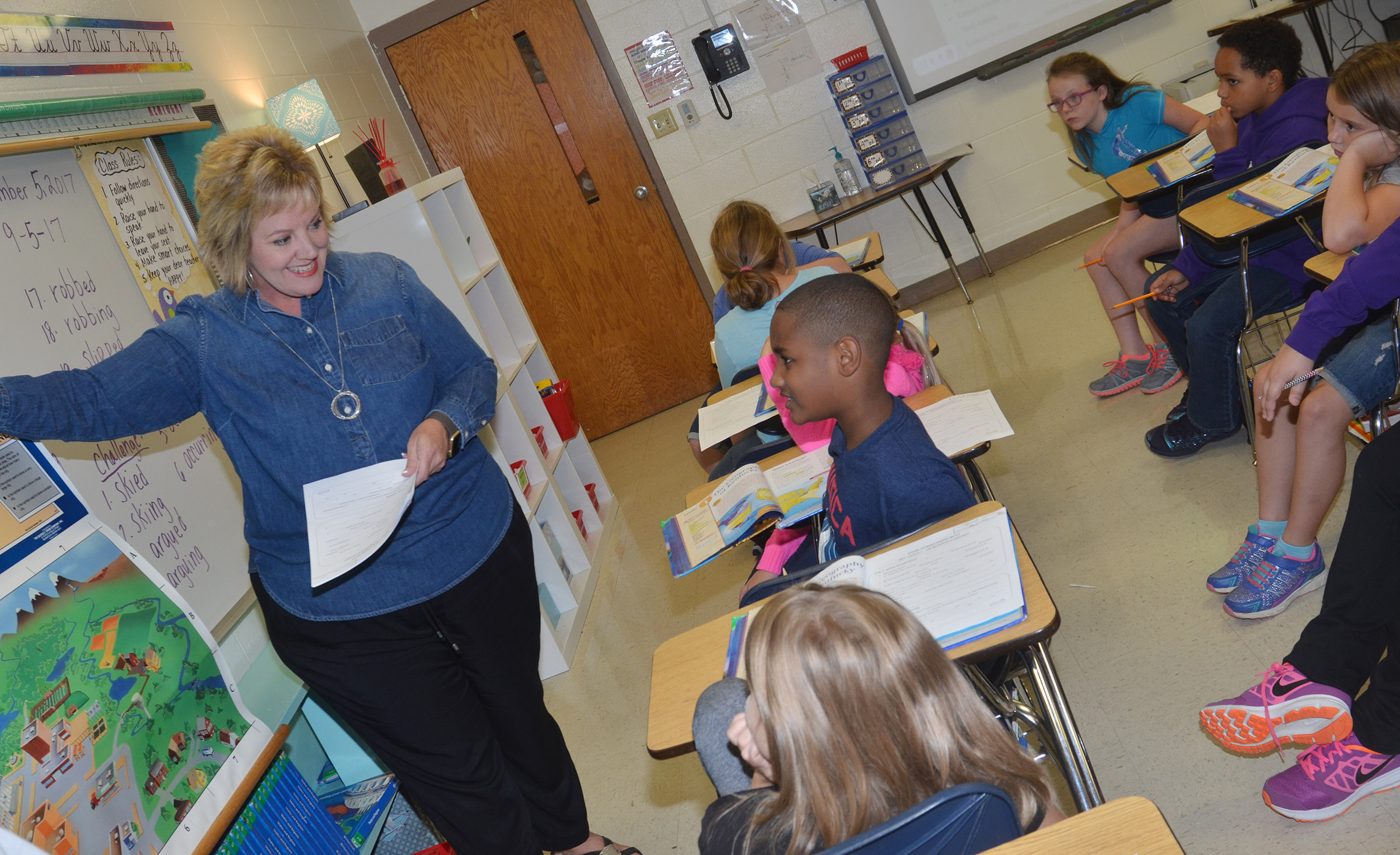 CES fourth-grade teacher Kaye Agathen talks to students about the equator.