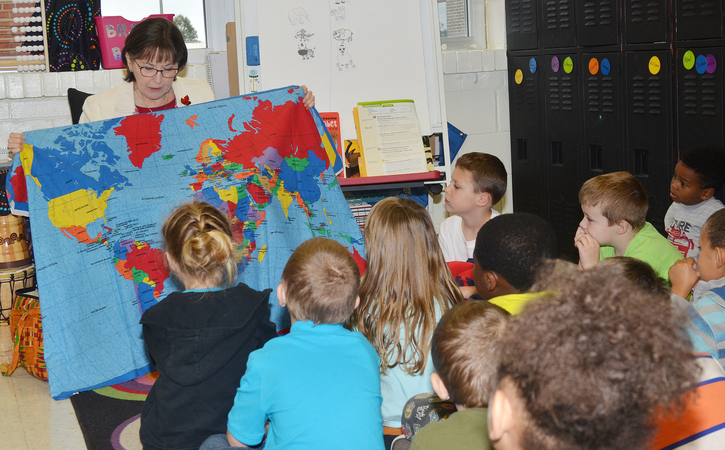 Penny Akers, a retired teacher, talks to CES kindergarteners about Africa.