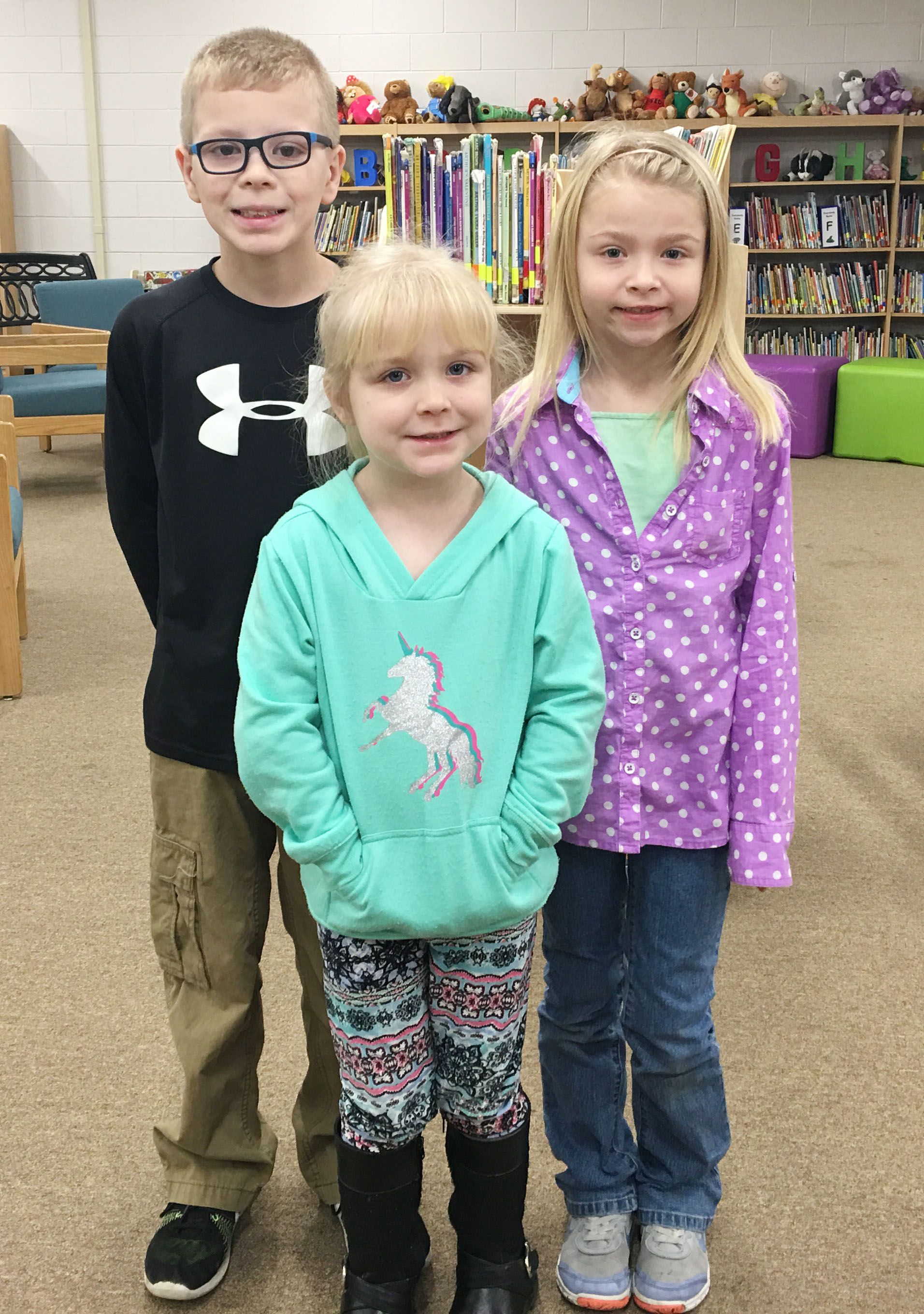 From left are third-grader Ethan Irwin, kindergartener Ava Bennett-Marr and second-grader Lacy Covey. First-grader Frehley Whitlow isn't pictured.