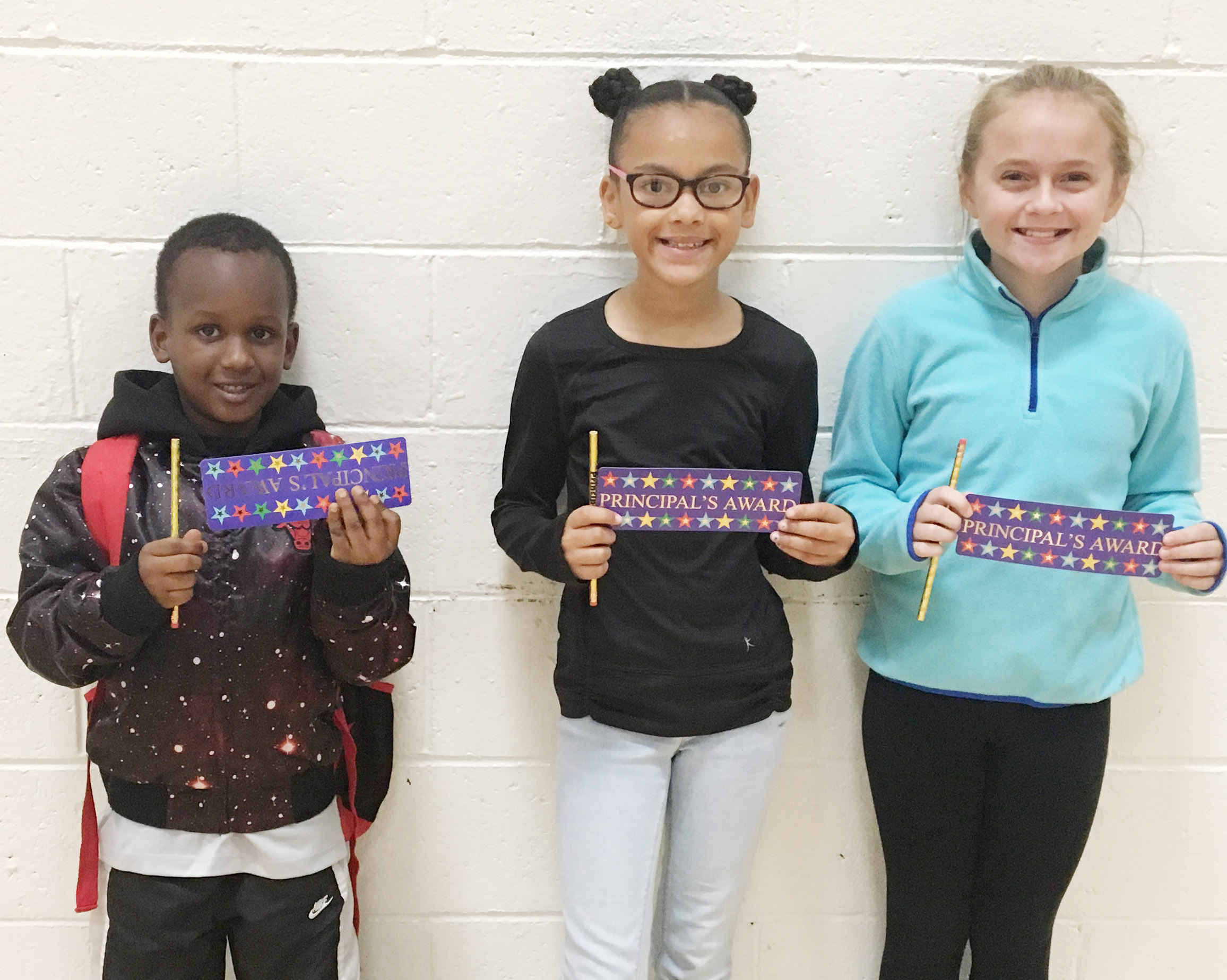From left are kindergartener Tureal Baxter, fourth-grader Alexia Howard and fifth-grader Kennedy Griffiths. Absent from the photo are first-grader Trinity Dye, second-grader Mason Edwards and third-grader Enoch Smith.
