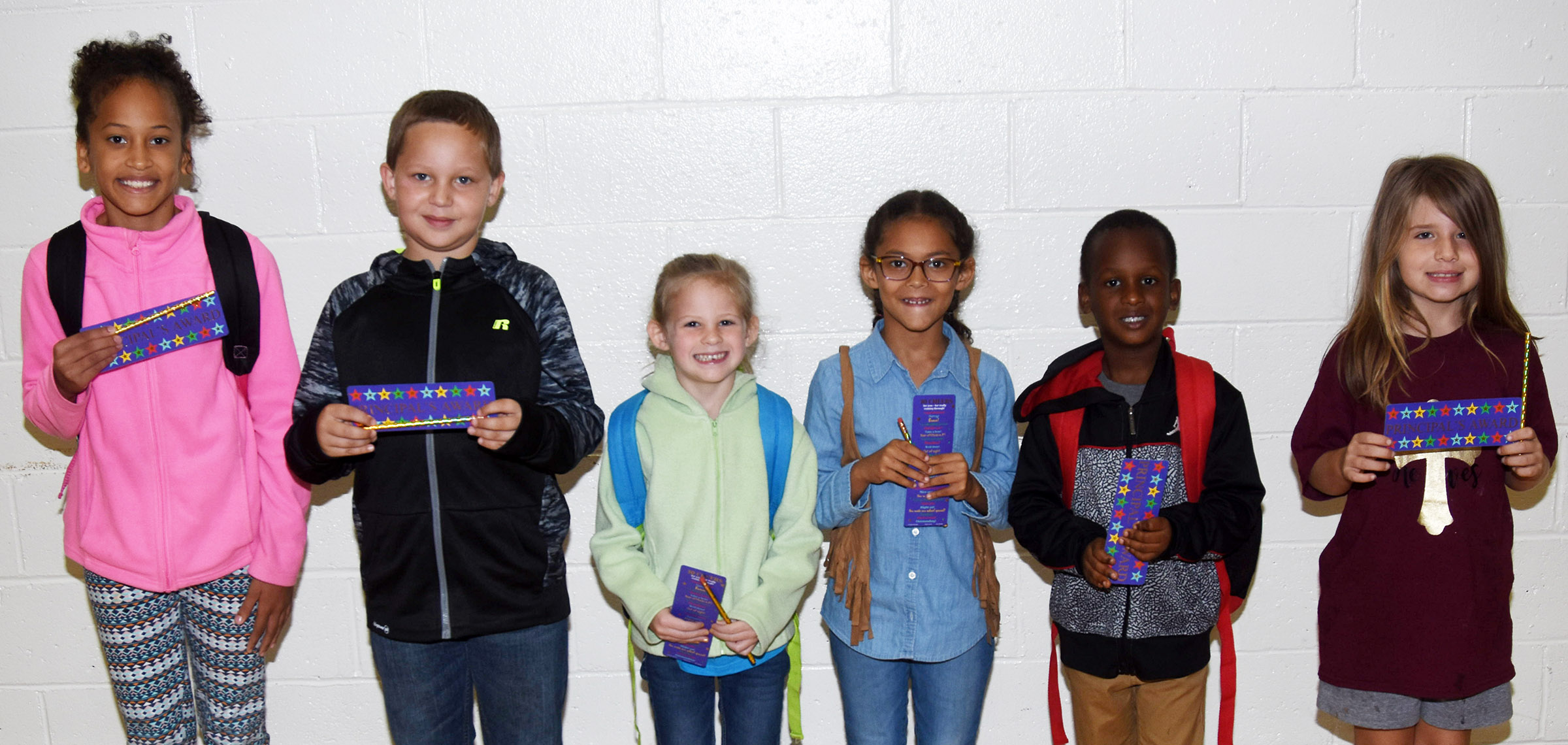 From left are fourth-grader Yazlyn Sutton, fifth-grader Jake Thompson, first-grader Riley Bright, second-grader Marlee Dickens, kindergartener TuReal Baxter and third-grader Kenady Hayes.
