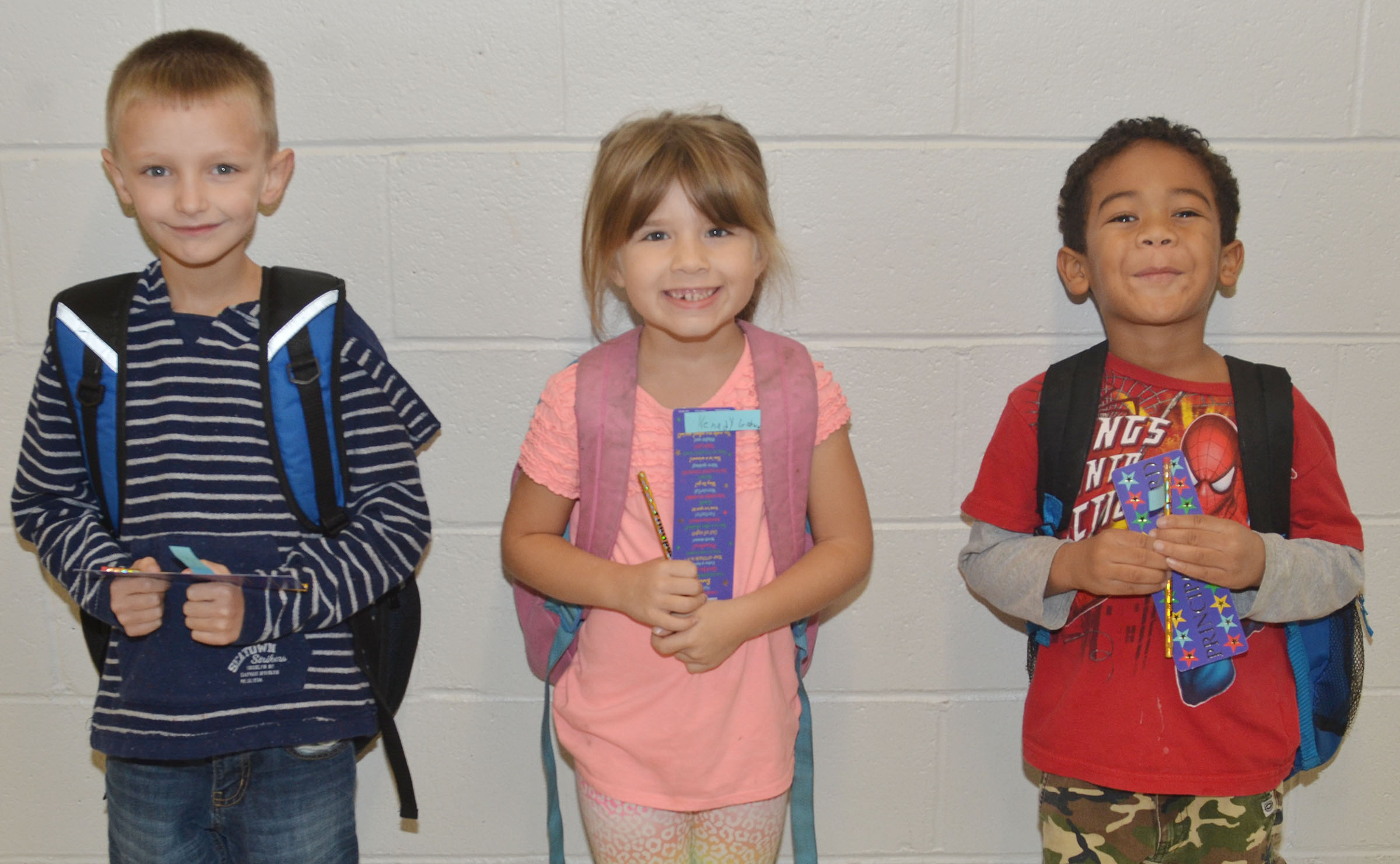 From left are second-grader Aaron Ritchie, first-grader Kenady Gabehart and kindergartener Tyler Branch. Third-grader Cameron Taylor isn't pictured.