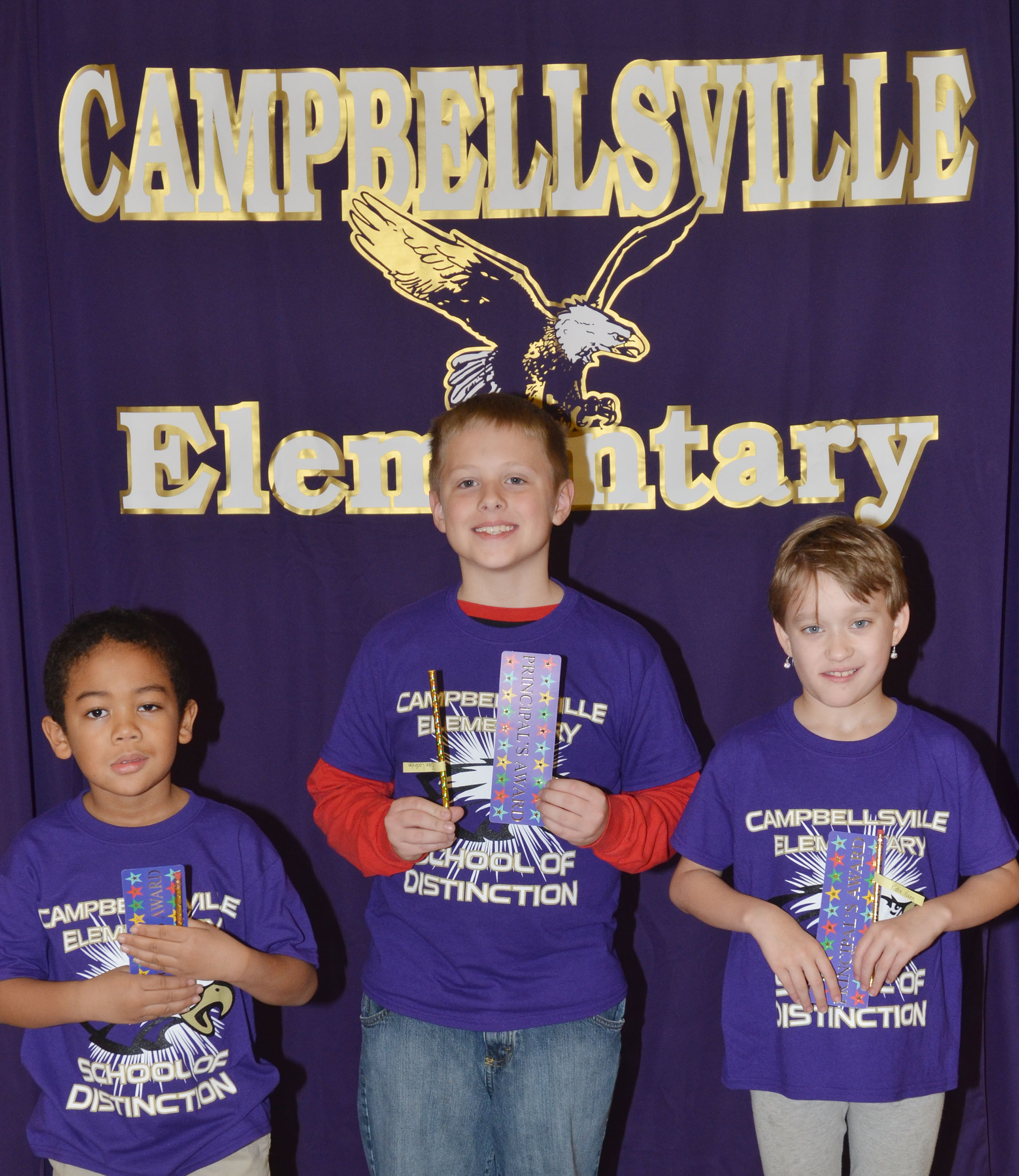 From left are kindergartener Tyler Branch, second-grader Evan Lockridge and third-grader Katie Nunn. Second-grader Brady Cox isn't pictured.