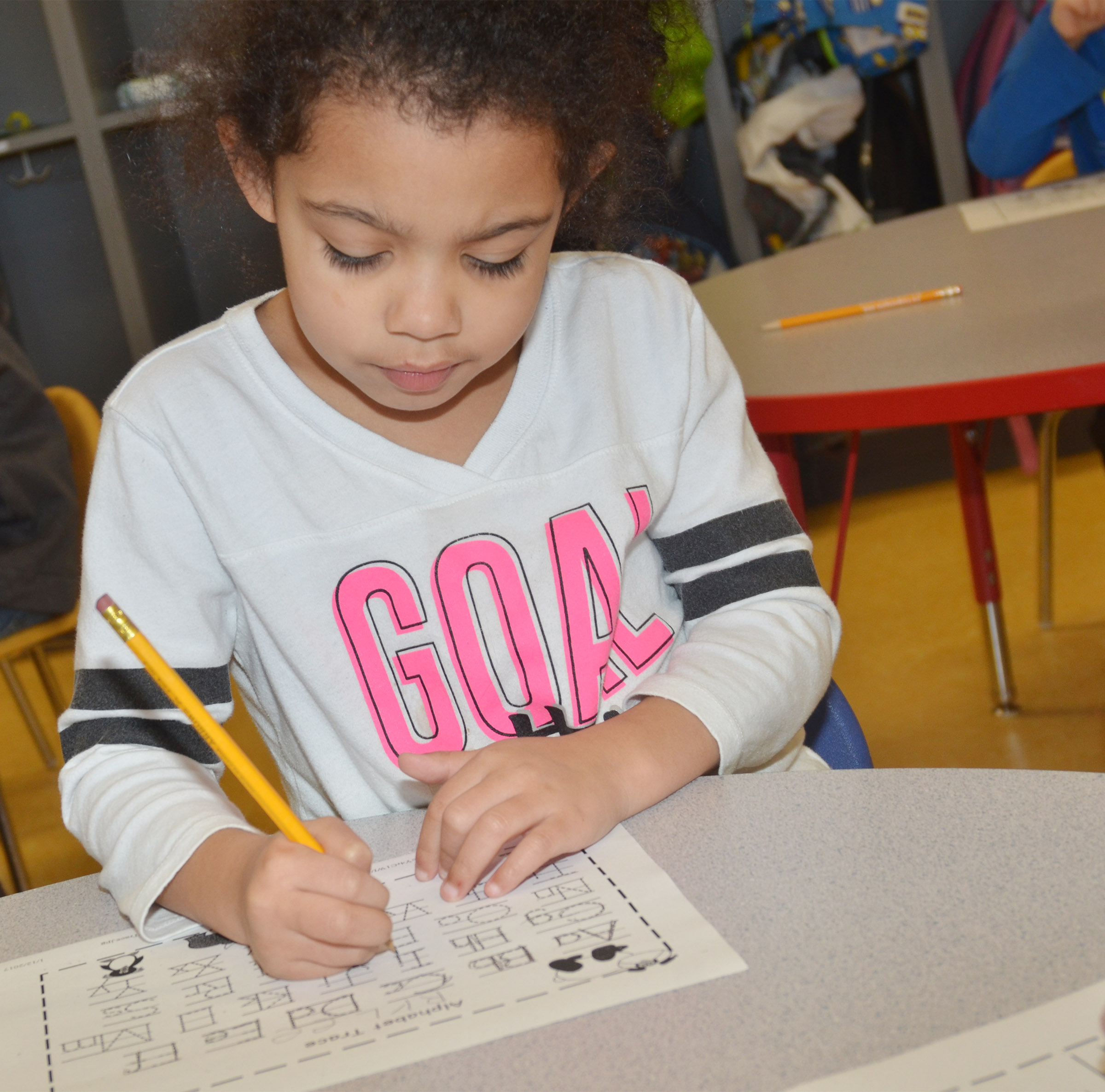 CES preschool student Rylee Karr practices writing the alphabet.