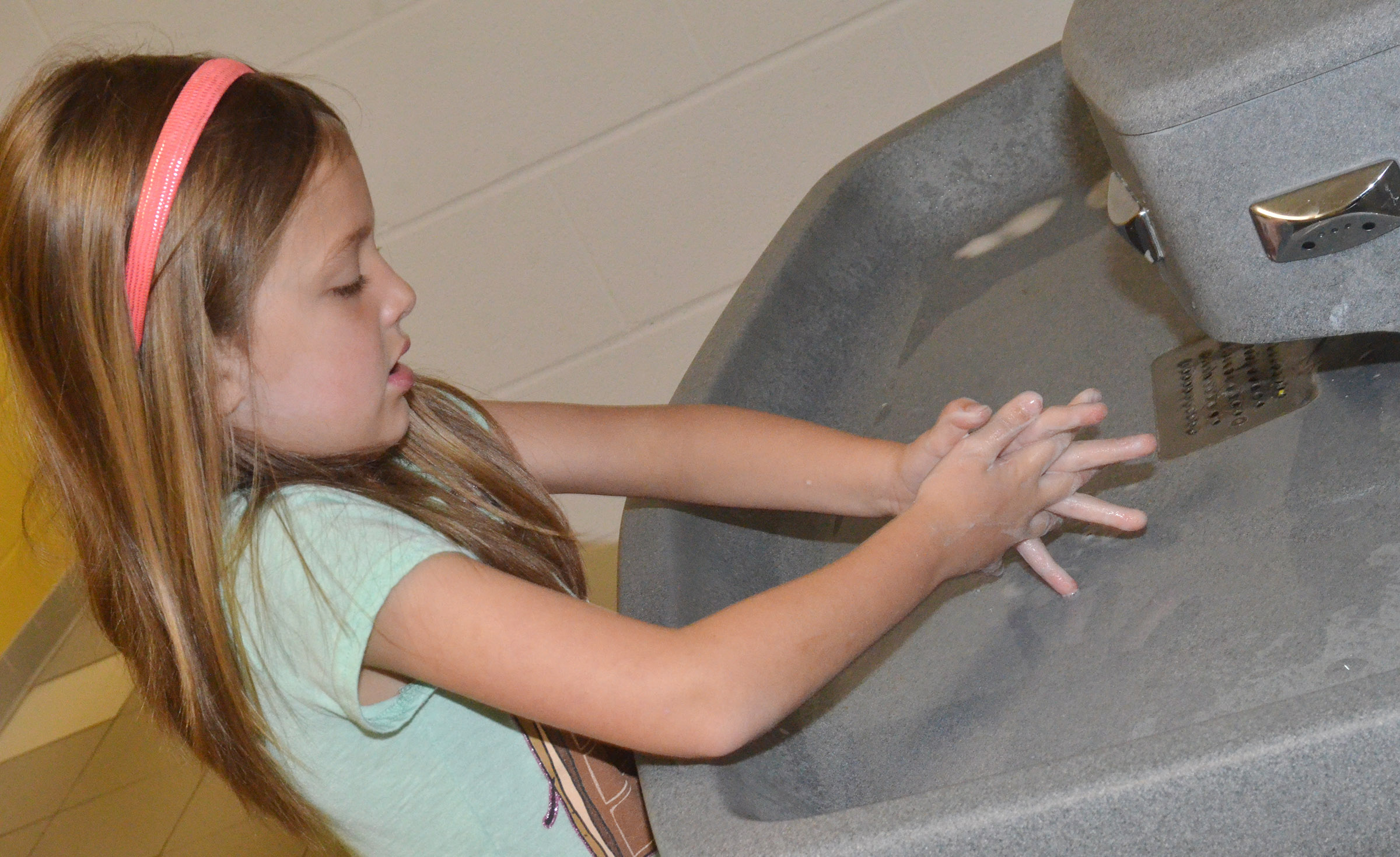 CES first-grader Delaney Staton practices washing her hands.