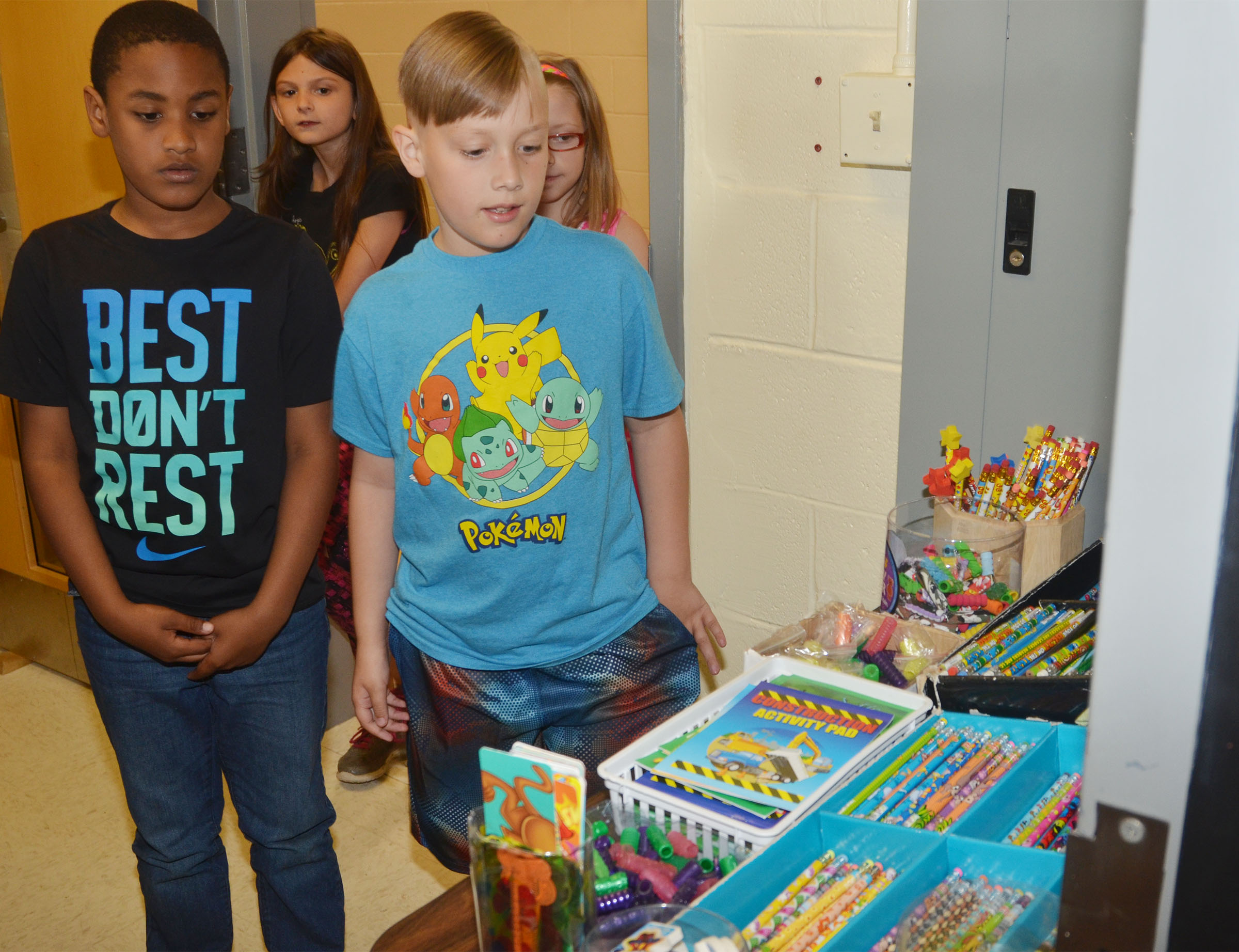 CES third-graders Shaiden Calhoun, at left, and Izak Burress shop with their AR points.