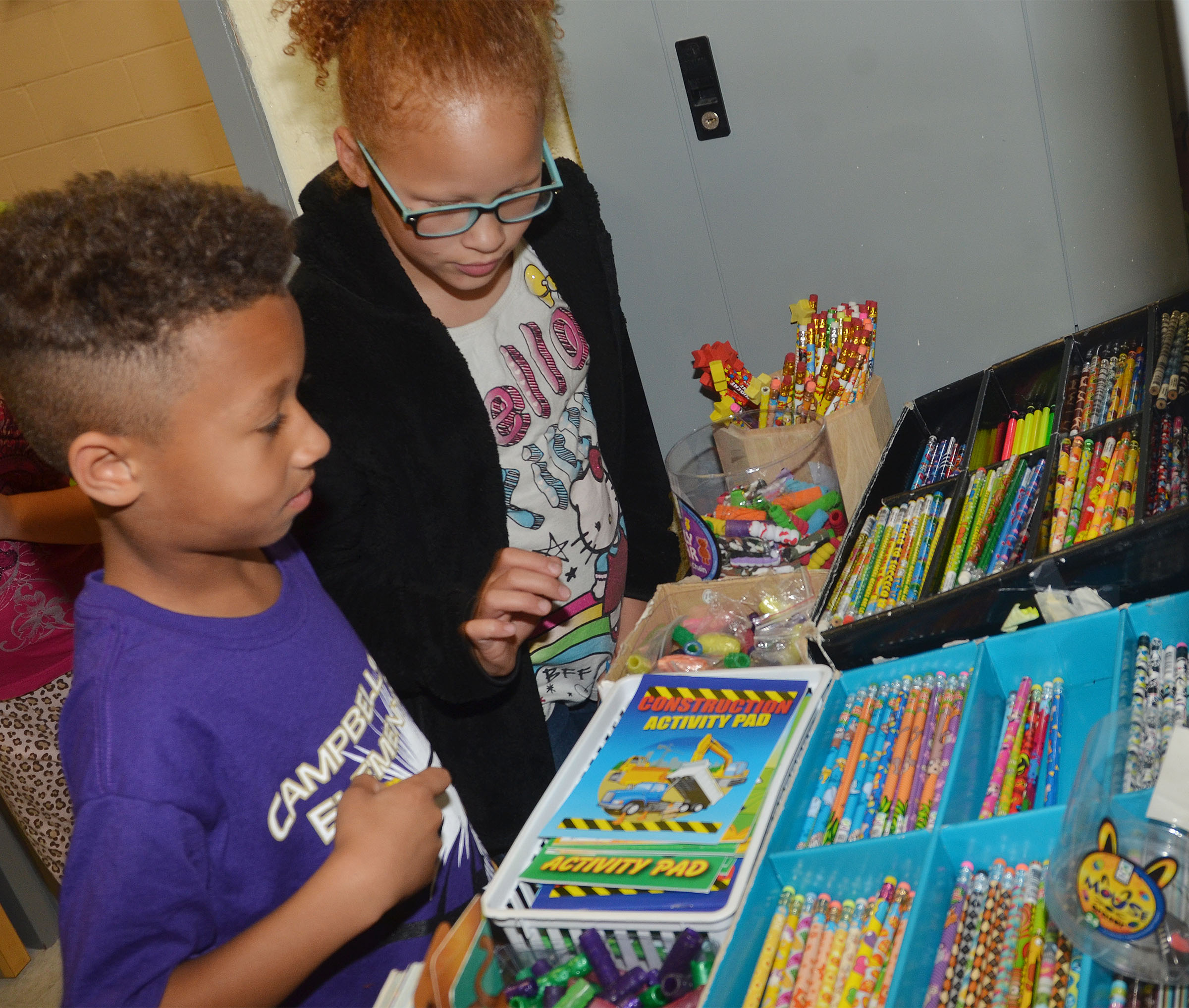 CES second-graders Rajon Taylor, at left, and Kallie Taylor shop with their AR points.