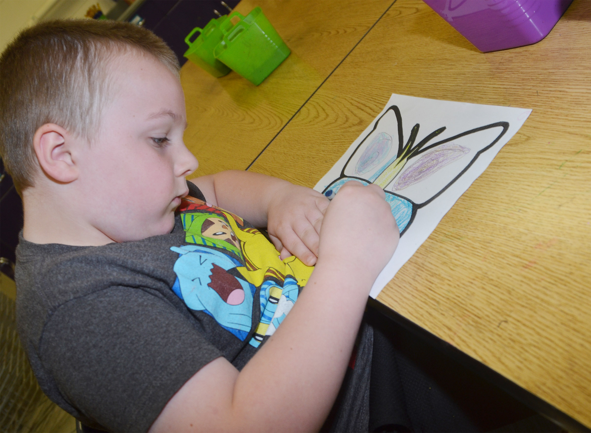 CES first-grader Hunter Clark creates symmetry as he colors his butterfly.