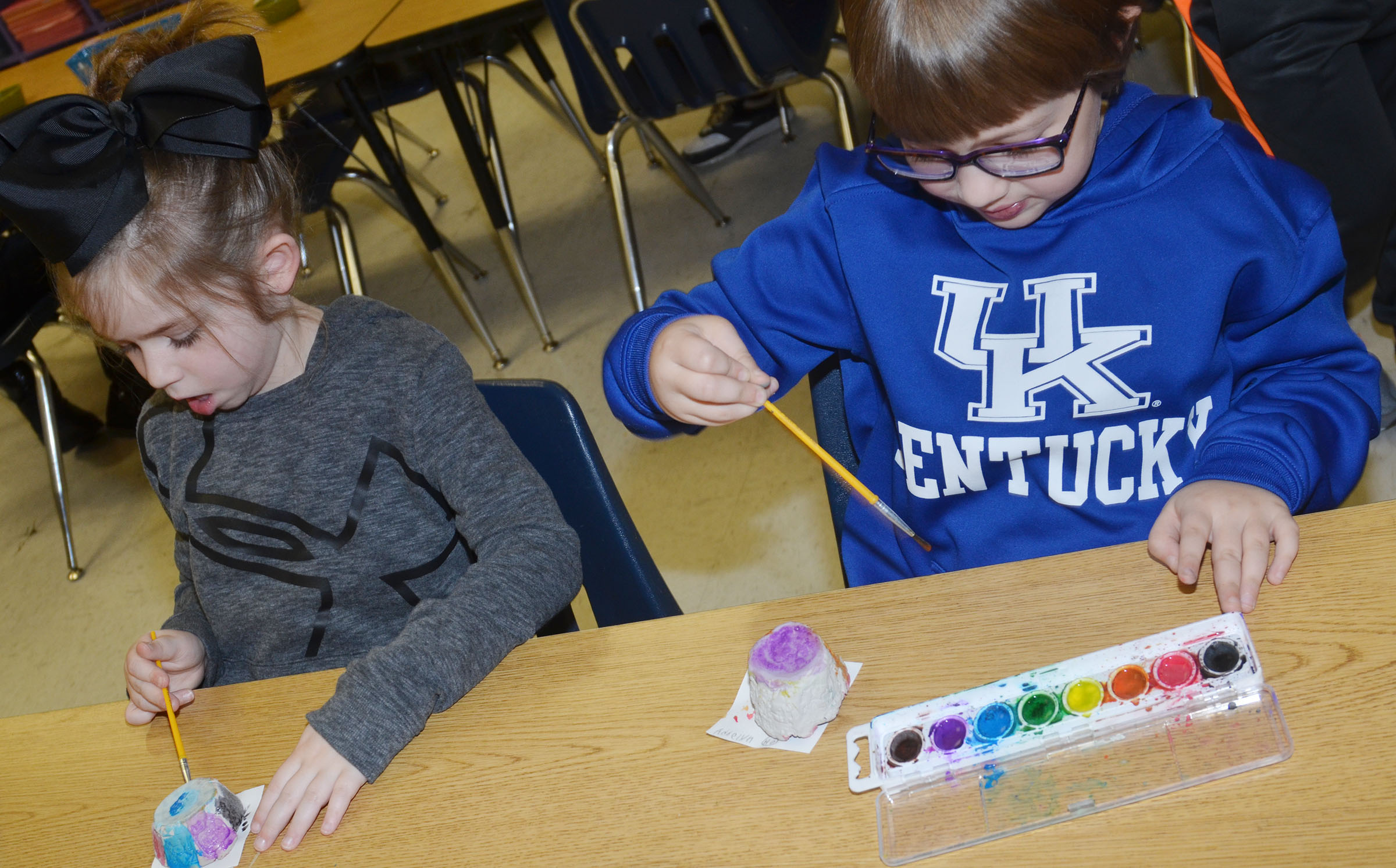 CES first-graders Lainey Price, at left, and Addelyn Dooley paint their pots.