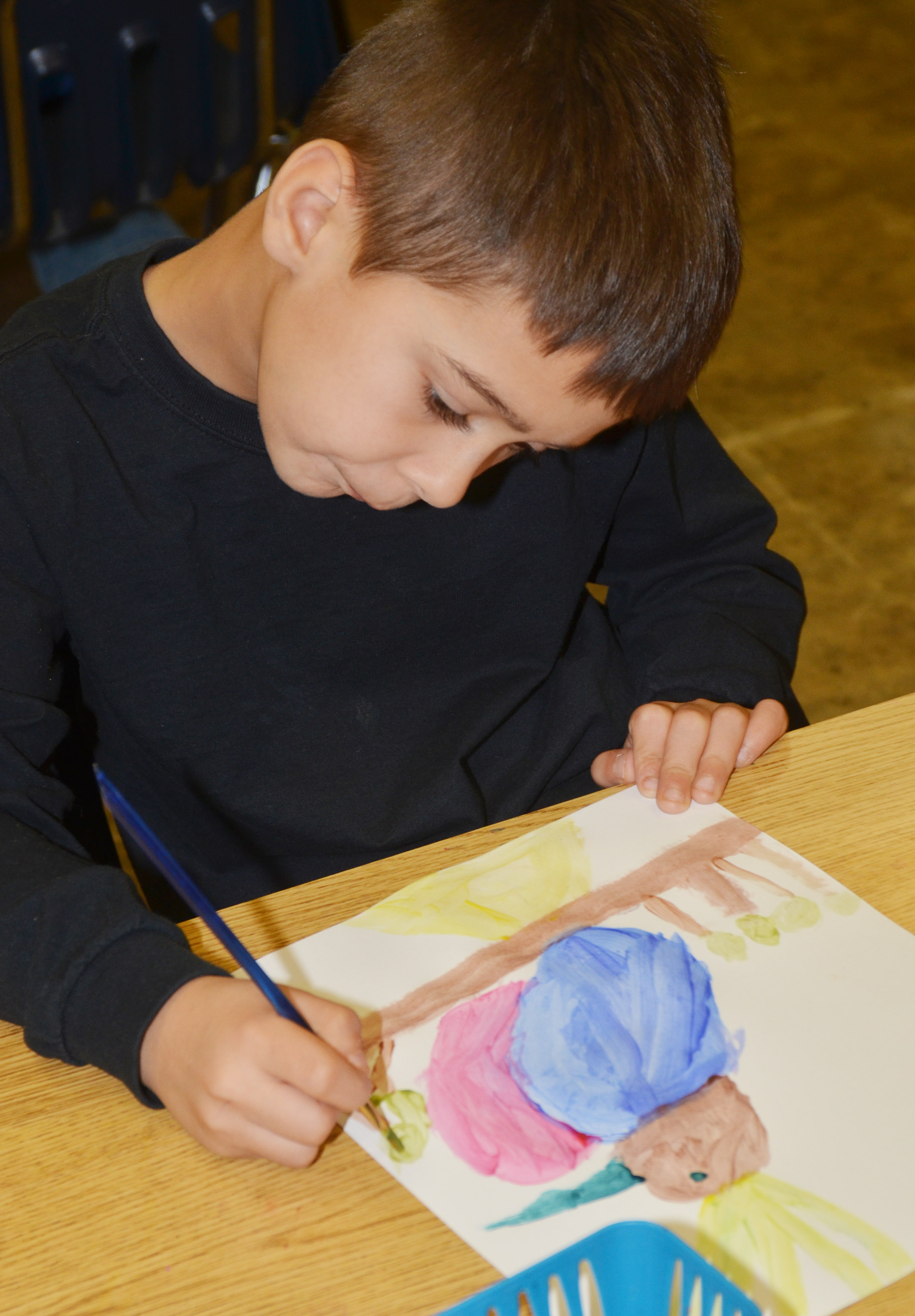 CES second-grader Brenden Chastain paints.