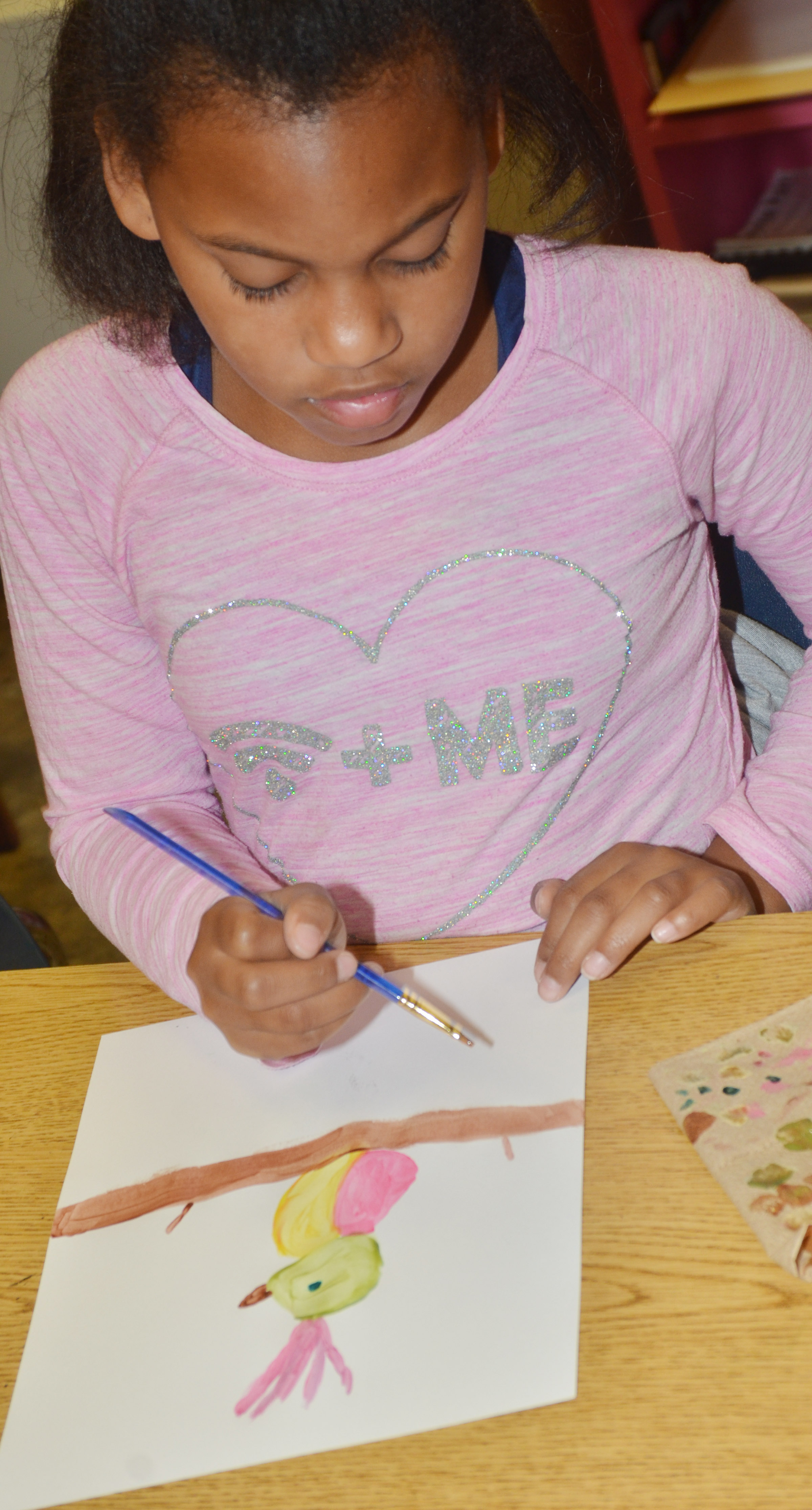 CES second-grader Ally Dunn paints.