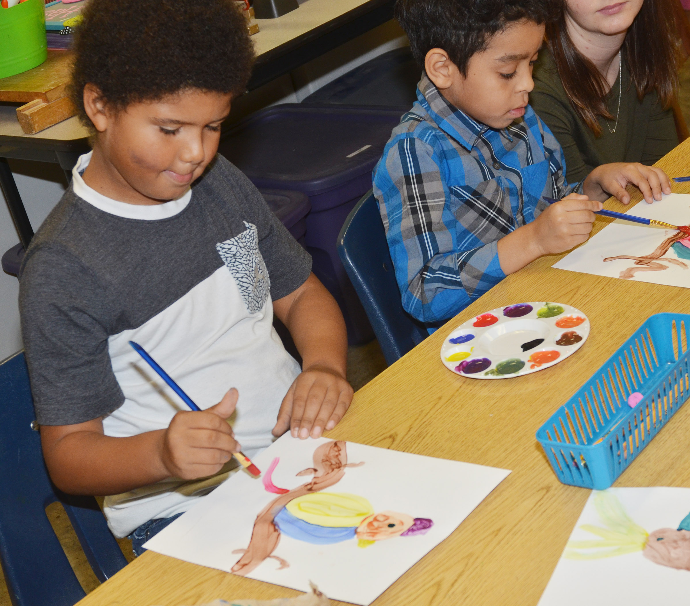 CES second-graders Navon Copeland, at left, and Jacob Hernandez paint.