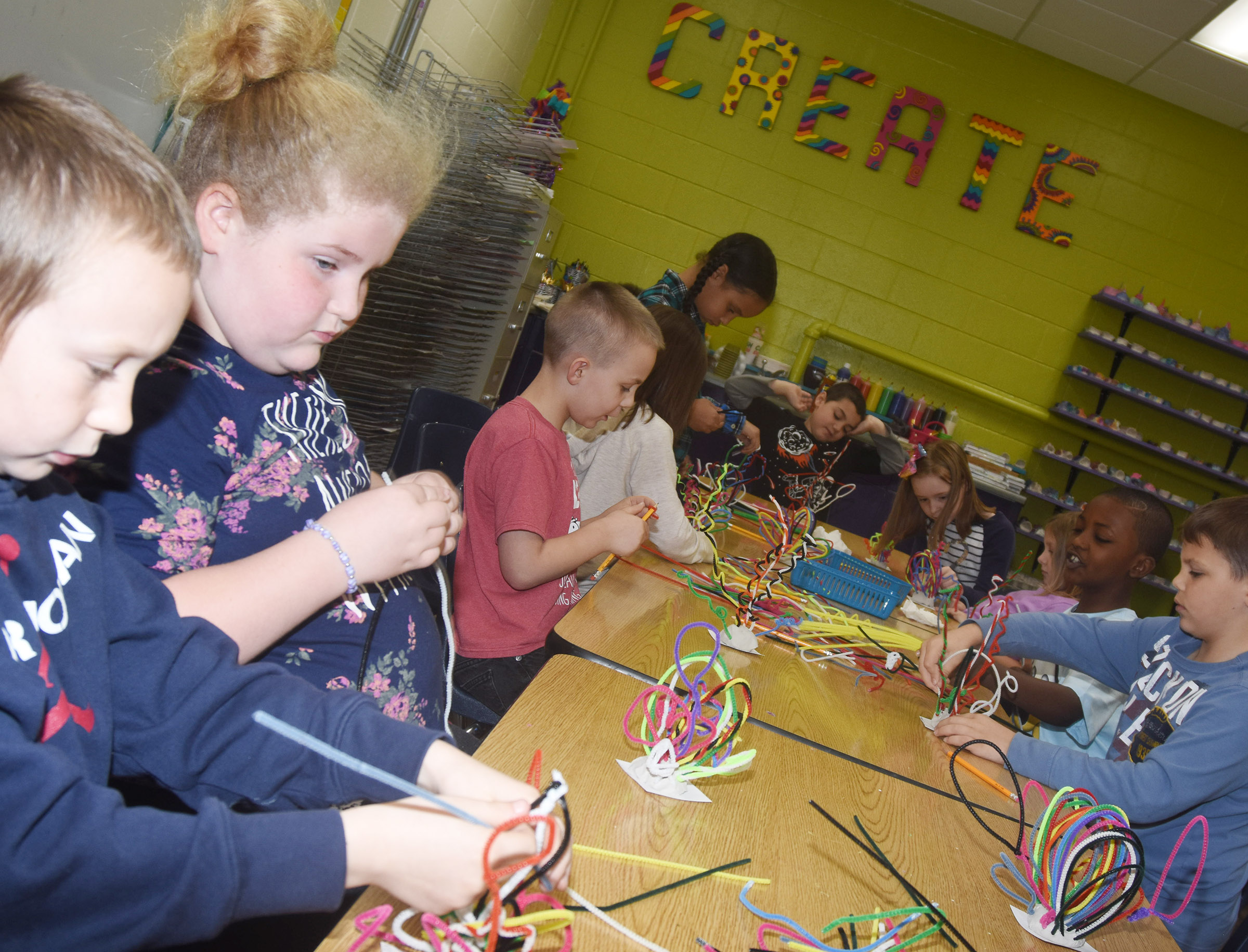 CES second-graders make their pipe cleaner sculptures.