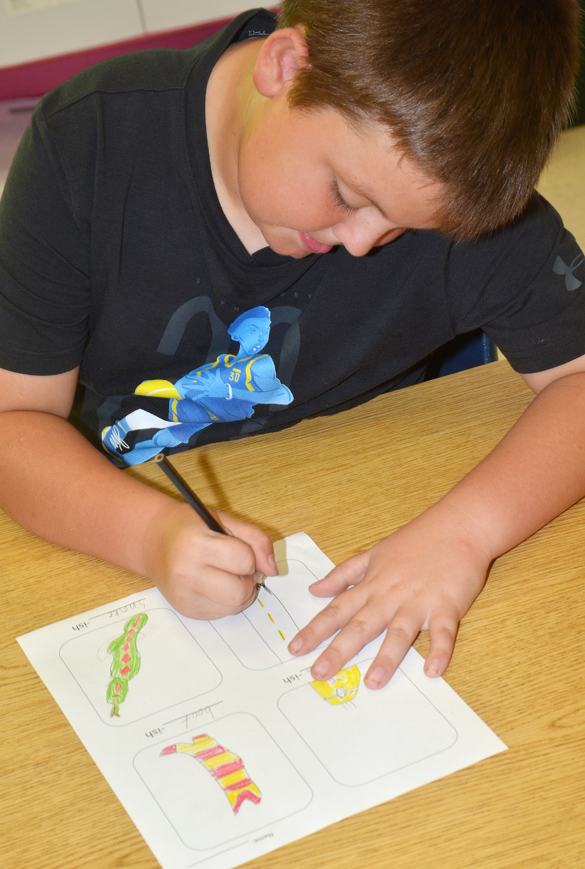 "CES third-grader Hayden Maupin colors his ""-ish"" drawings."