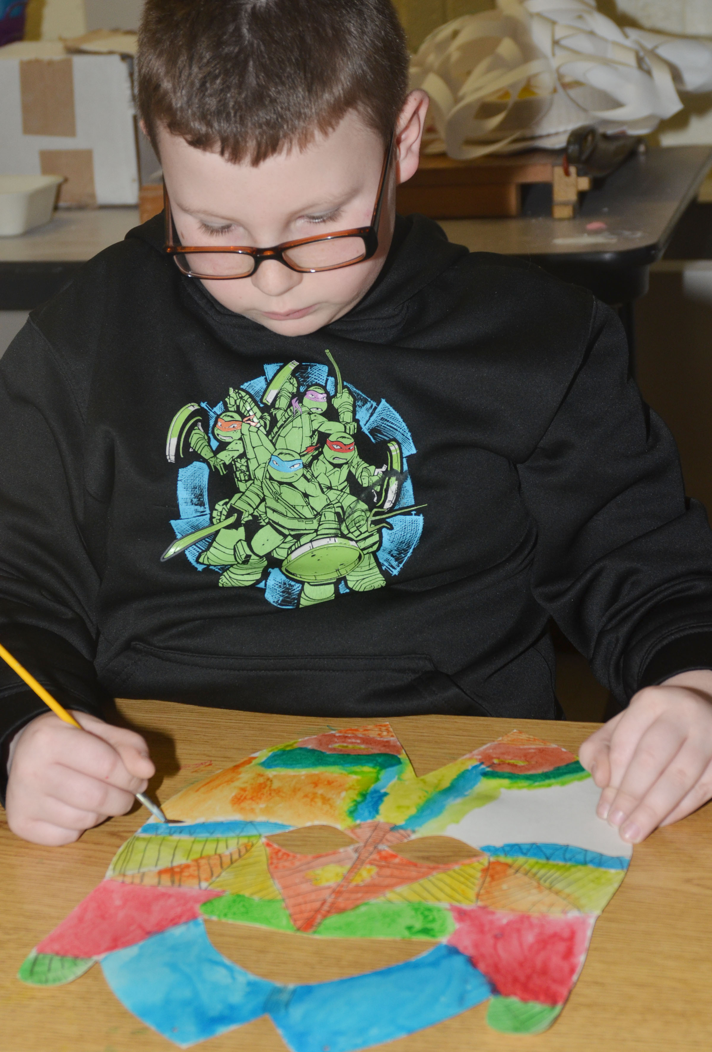 CES third-grader Lucas Gribbins paints his African mask.