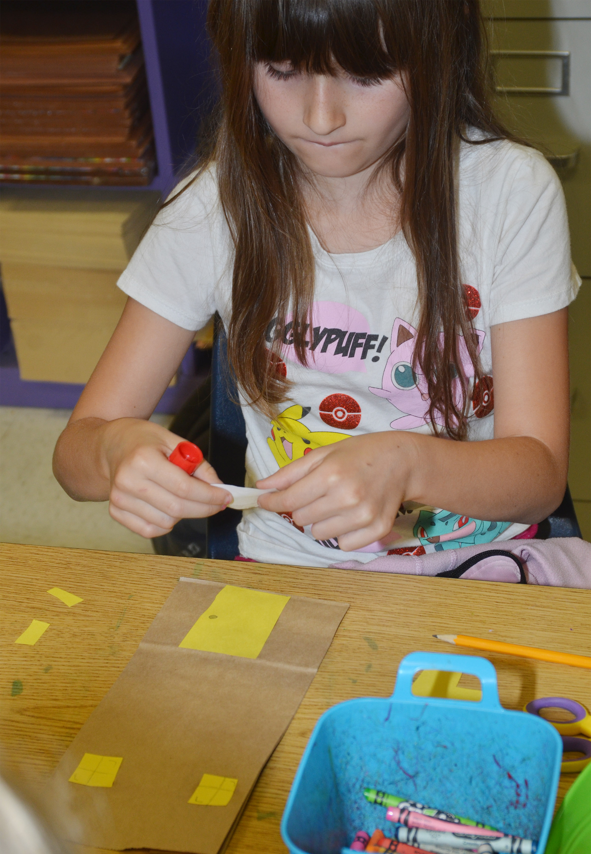 CES second-grader Cadence Burton makes her paper building.