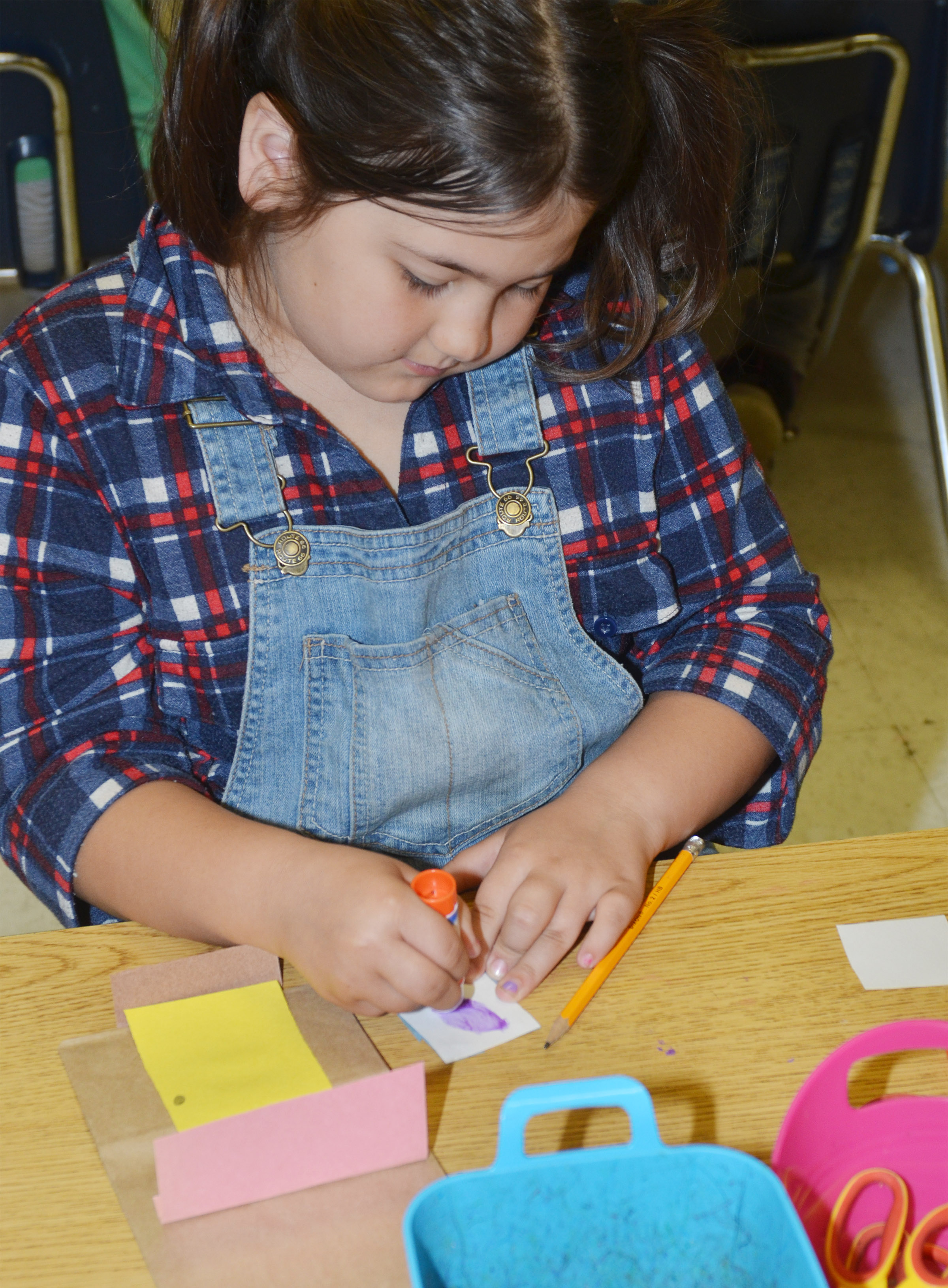 CES second-grader Marissa Sumners makes her paper building.