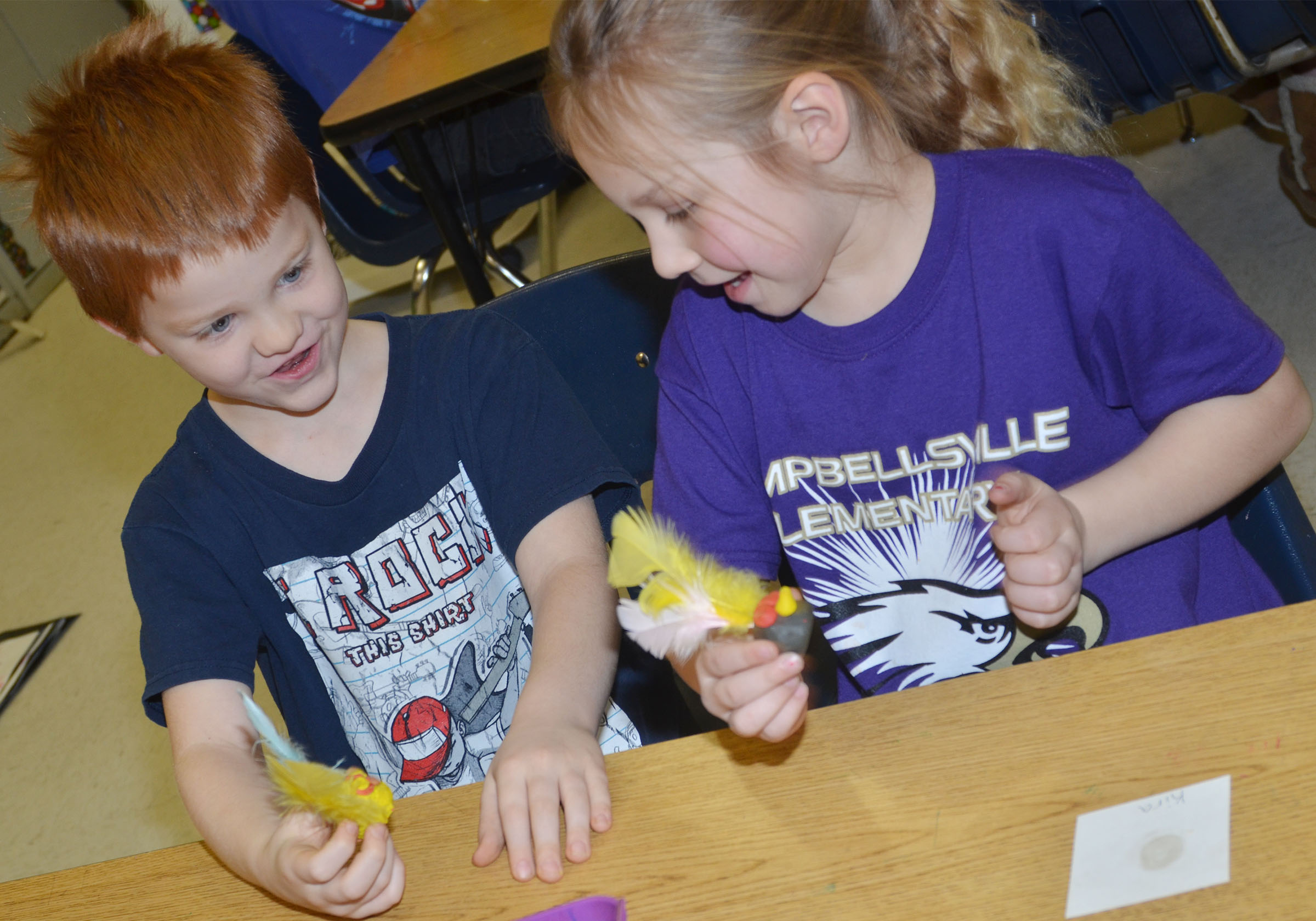 CES kindergarteners Cambrien Couch, at left, and Kira Dotson talk about their owls.