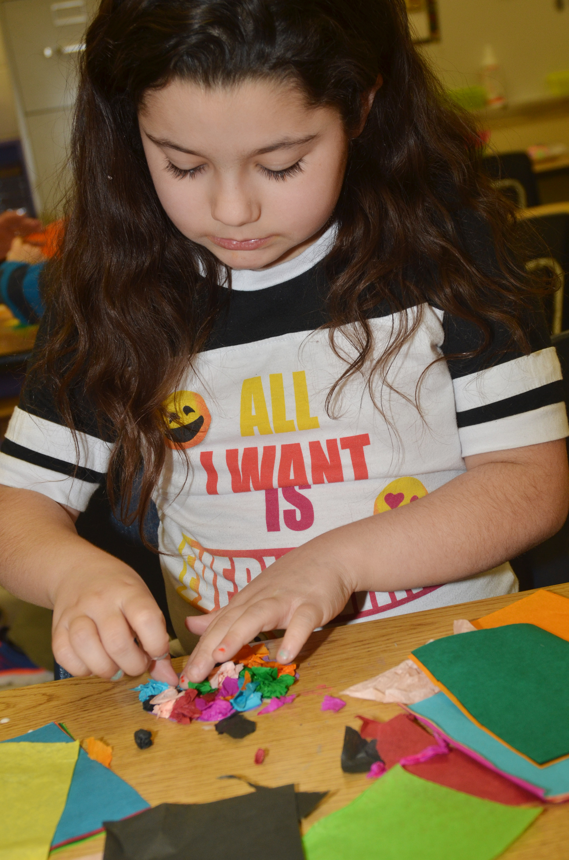CES third-grader Brooklyn Boudreaux makes a paper flower.