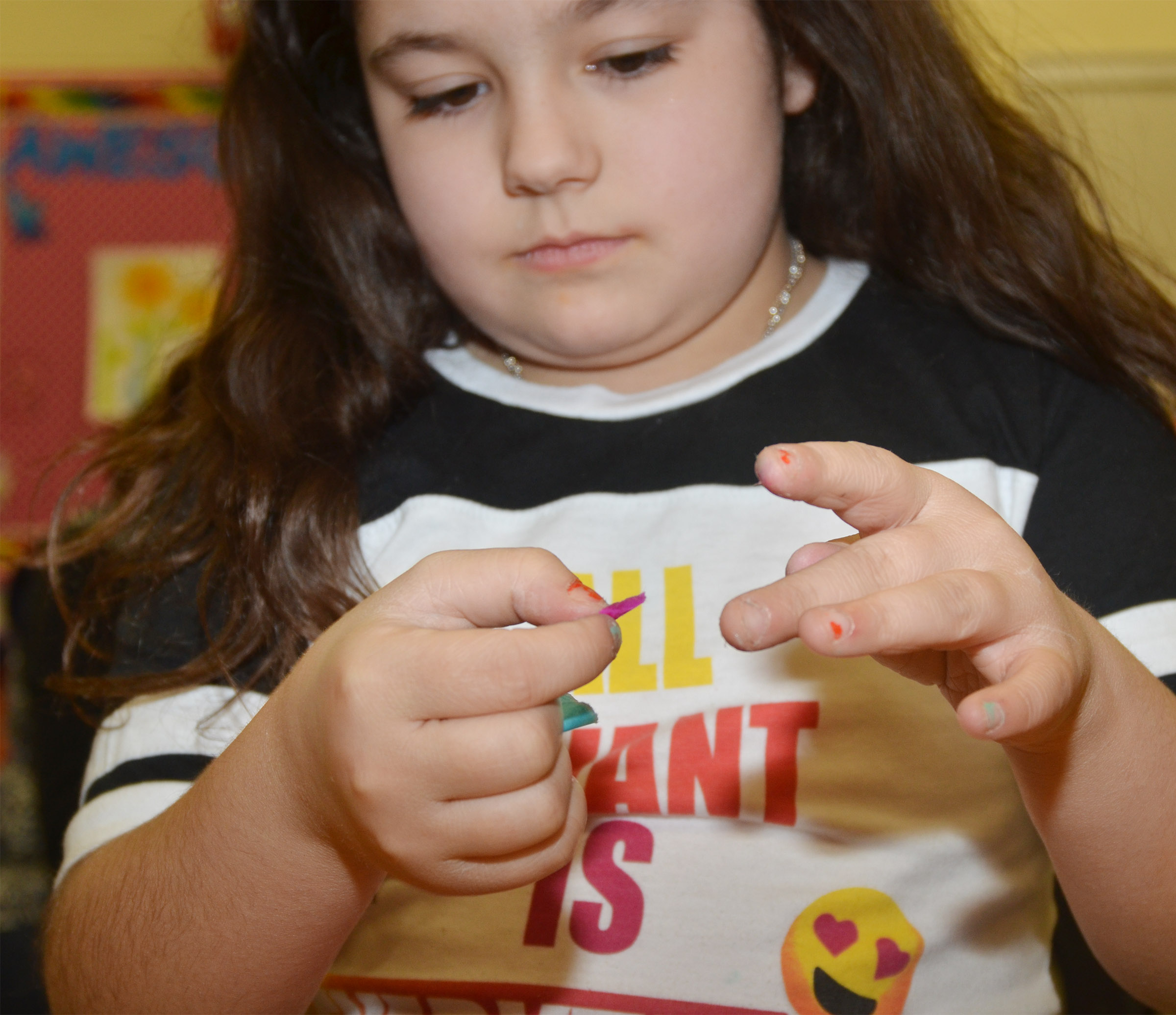 CES third-grader Brooklyn Boudreaux folds paper to make a flower.