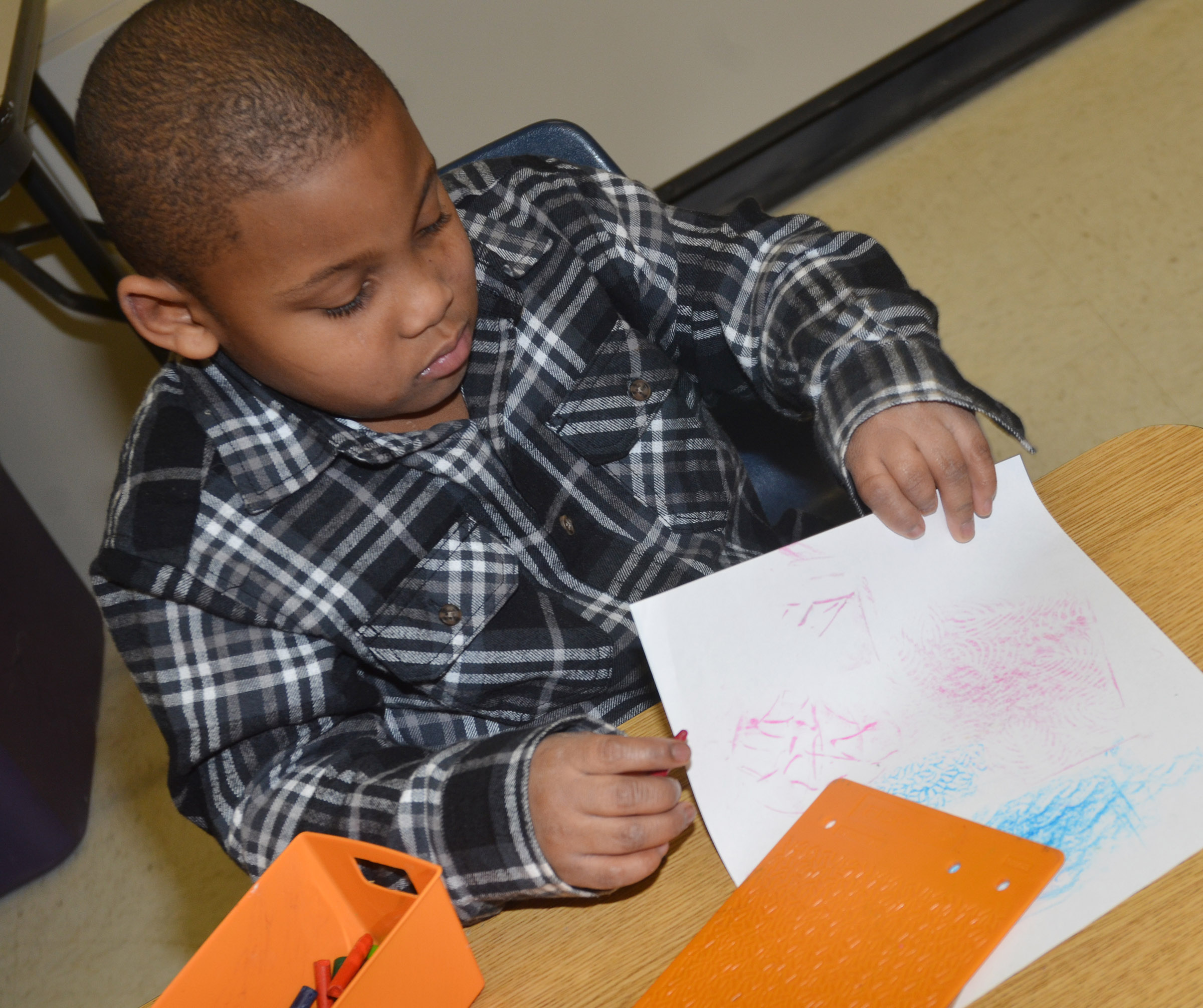 CES kindergartener Malachi Conner rubs patterns.