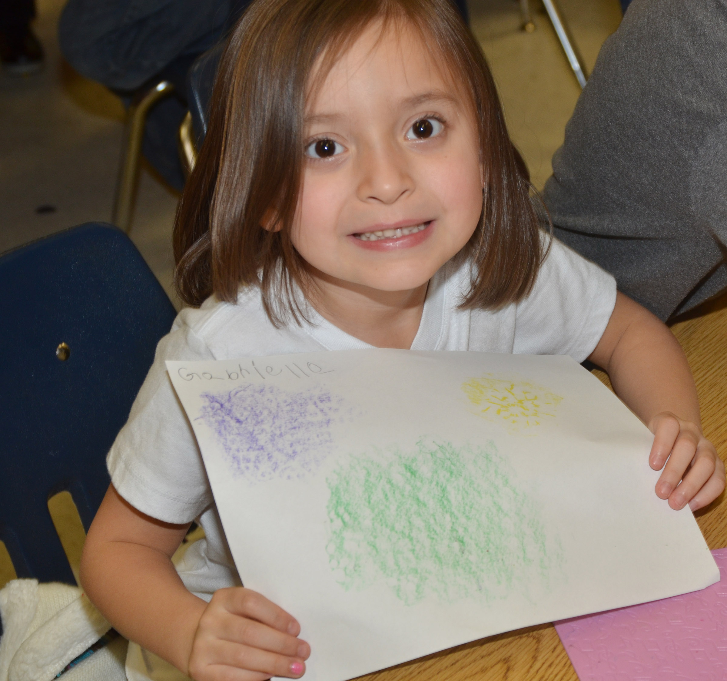 CES kindergartener Gabriella Tate holds her patterns.