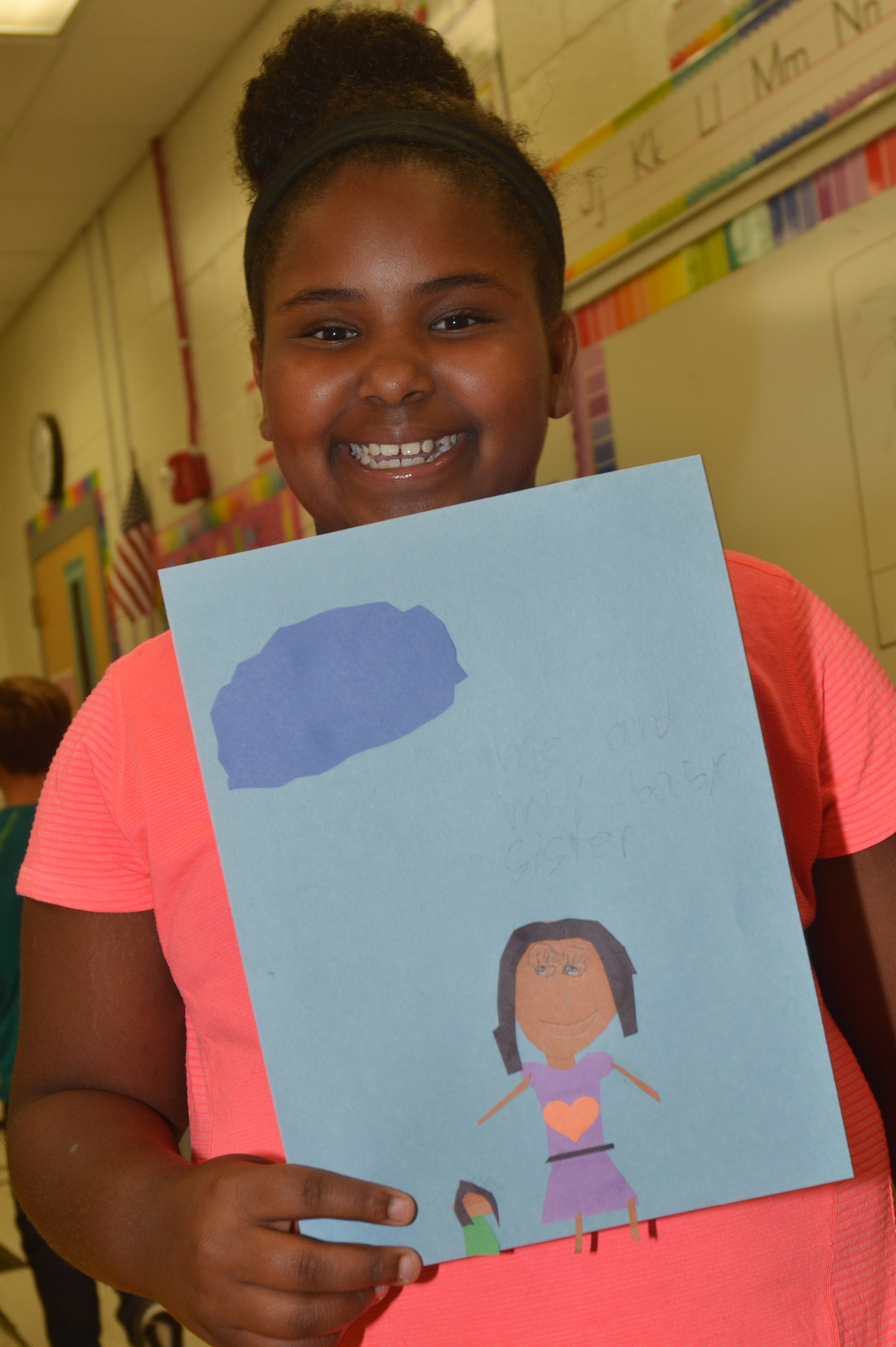 CES third-grader Ajada Smith holds her finished drawing.