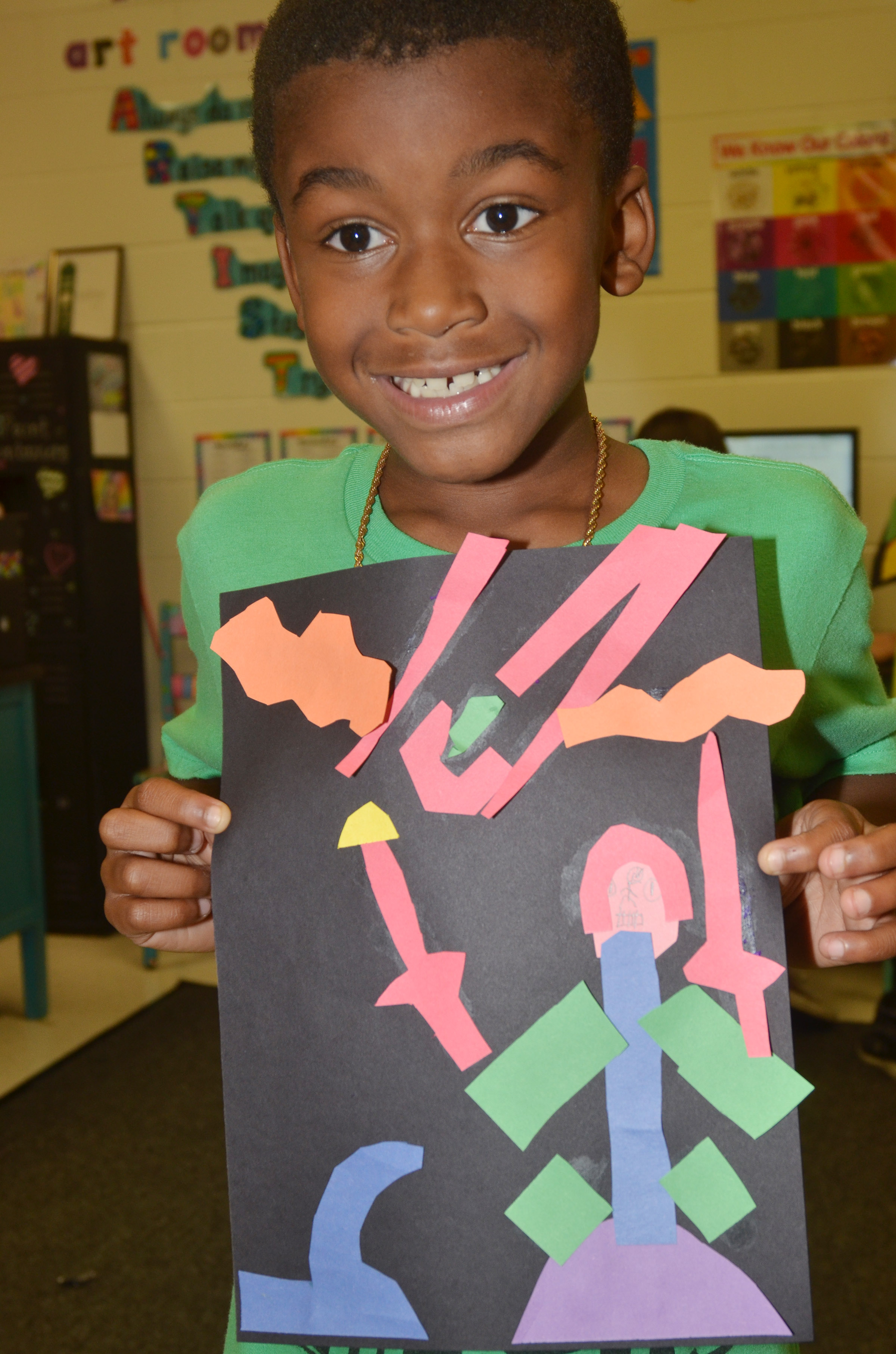 CES third-grader Kae'vin Spaulding holds his finished drawing.