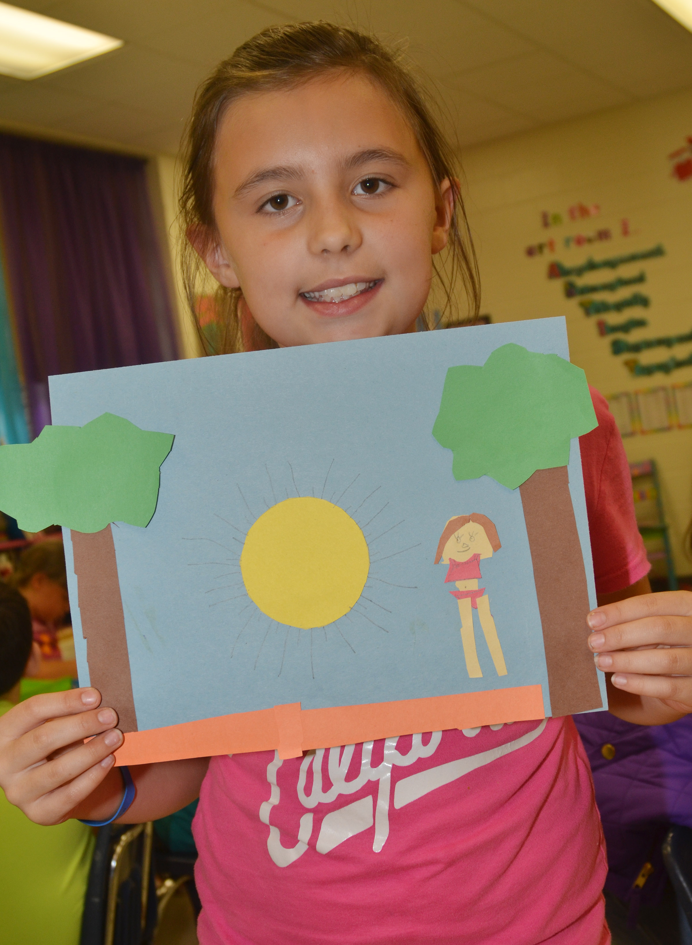 CES third-grader Annabelle Brockman holds her finished drawing.